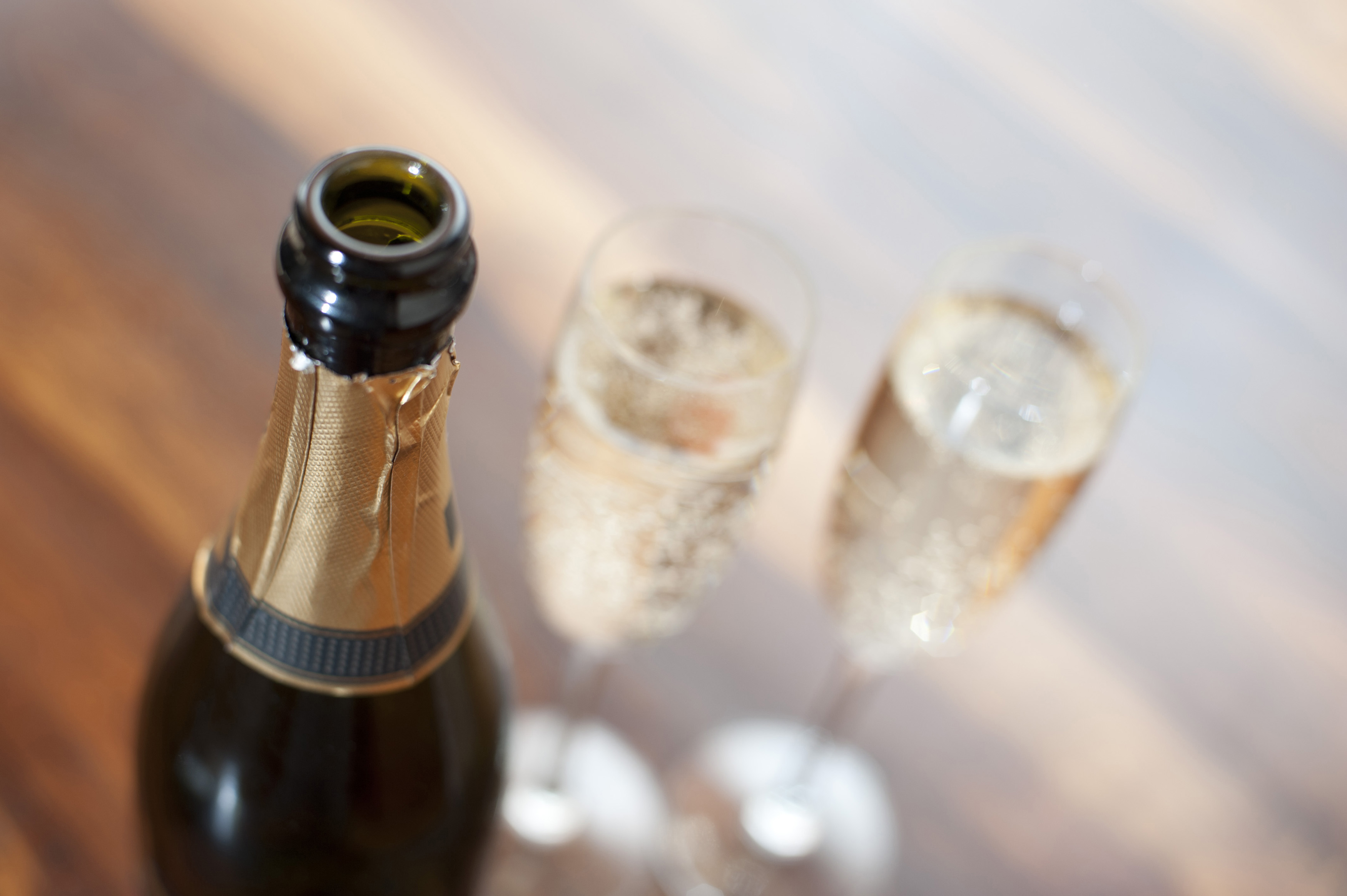 Open champagne bottle with full glasses - Free Stock Image