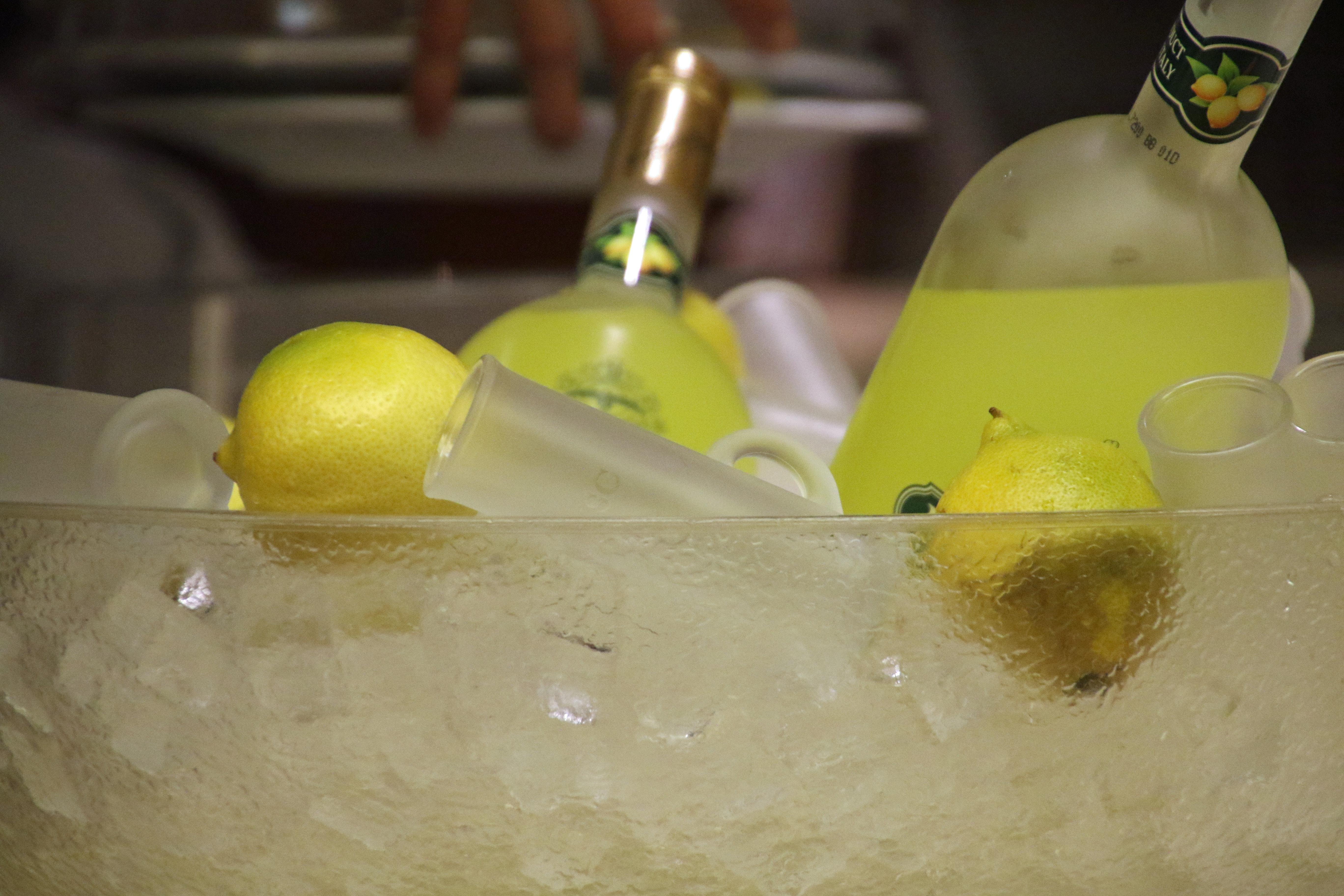 Bottles of lemon beverage in the ice photo
