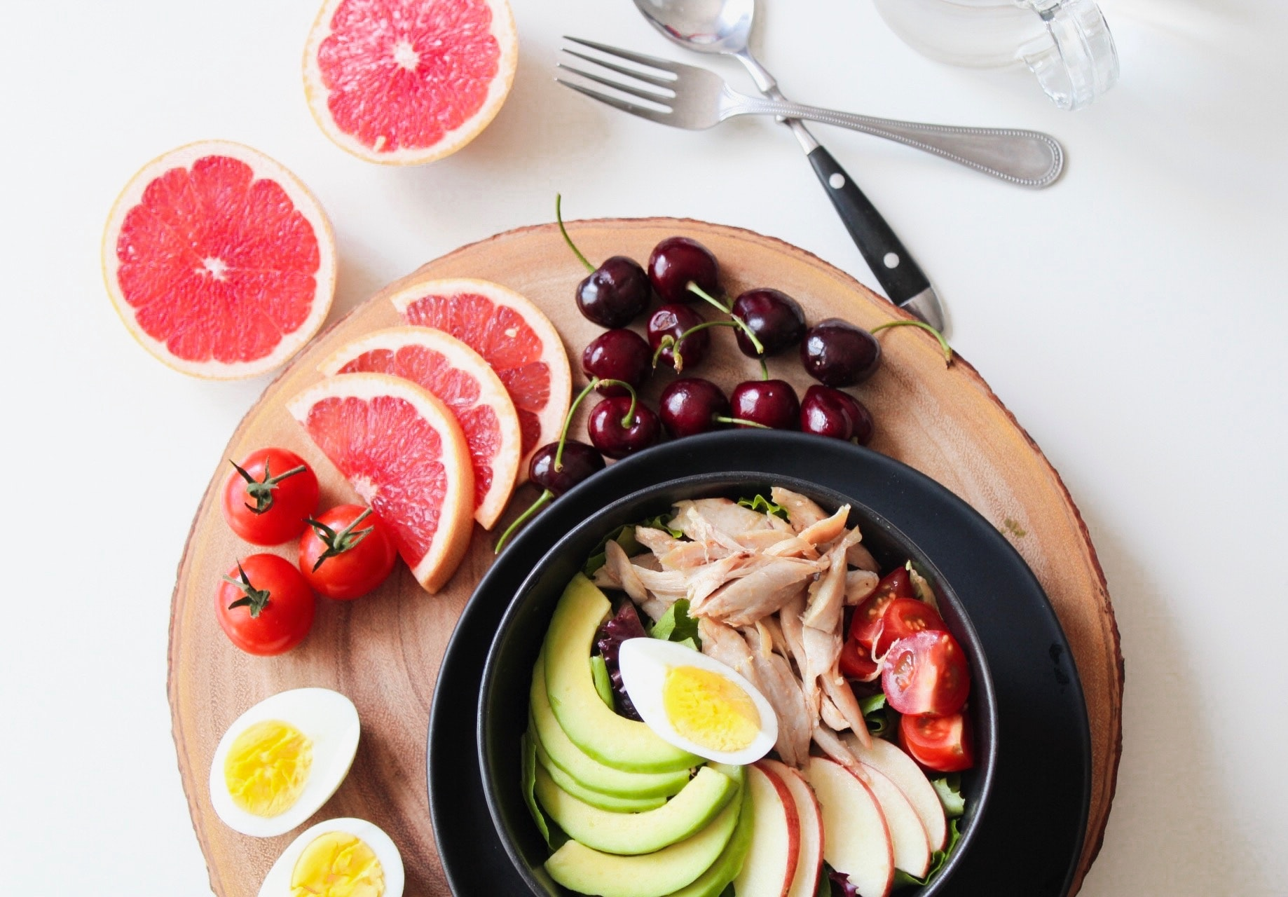 Bowl of vegetable salad and fruits photo