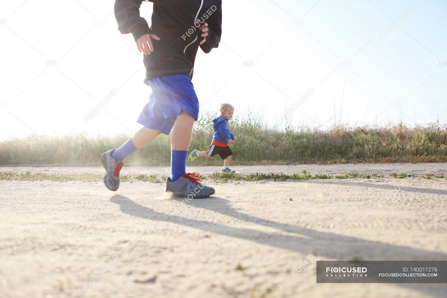 Boys running outdoors photo