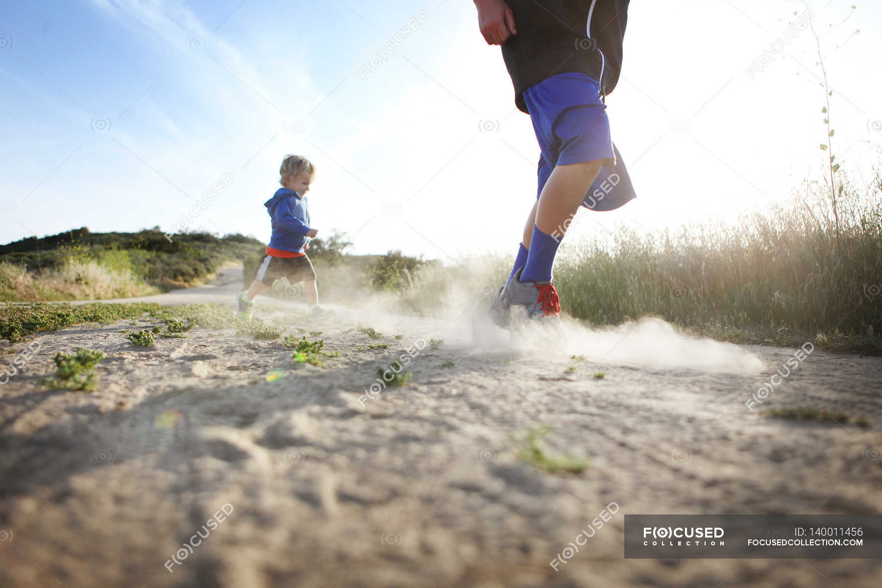 Two boys running outdoors — Stock Photo | #140011456