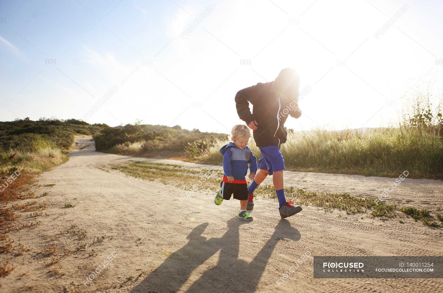 Chasing - Stock Photos, Royalty Free Images | Focused