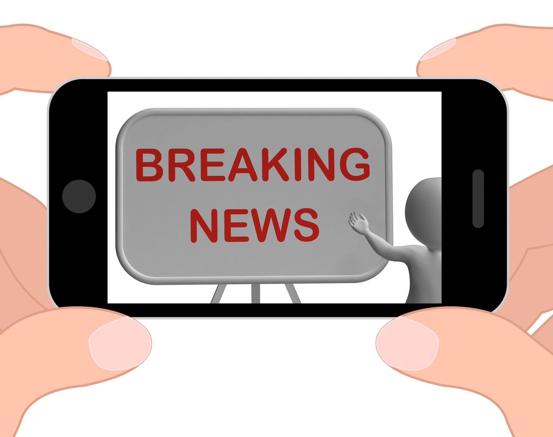 Breaking news phone shows major developments and bulletin photo