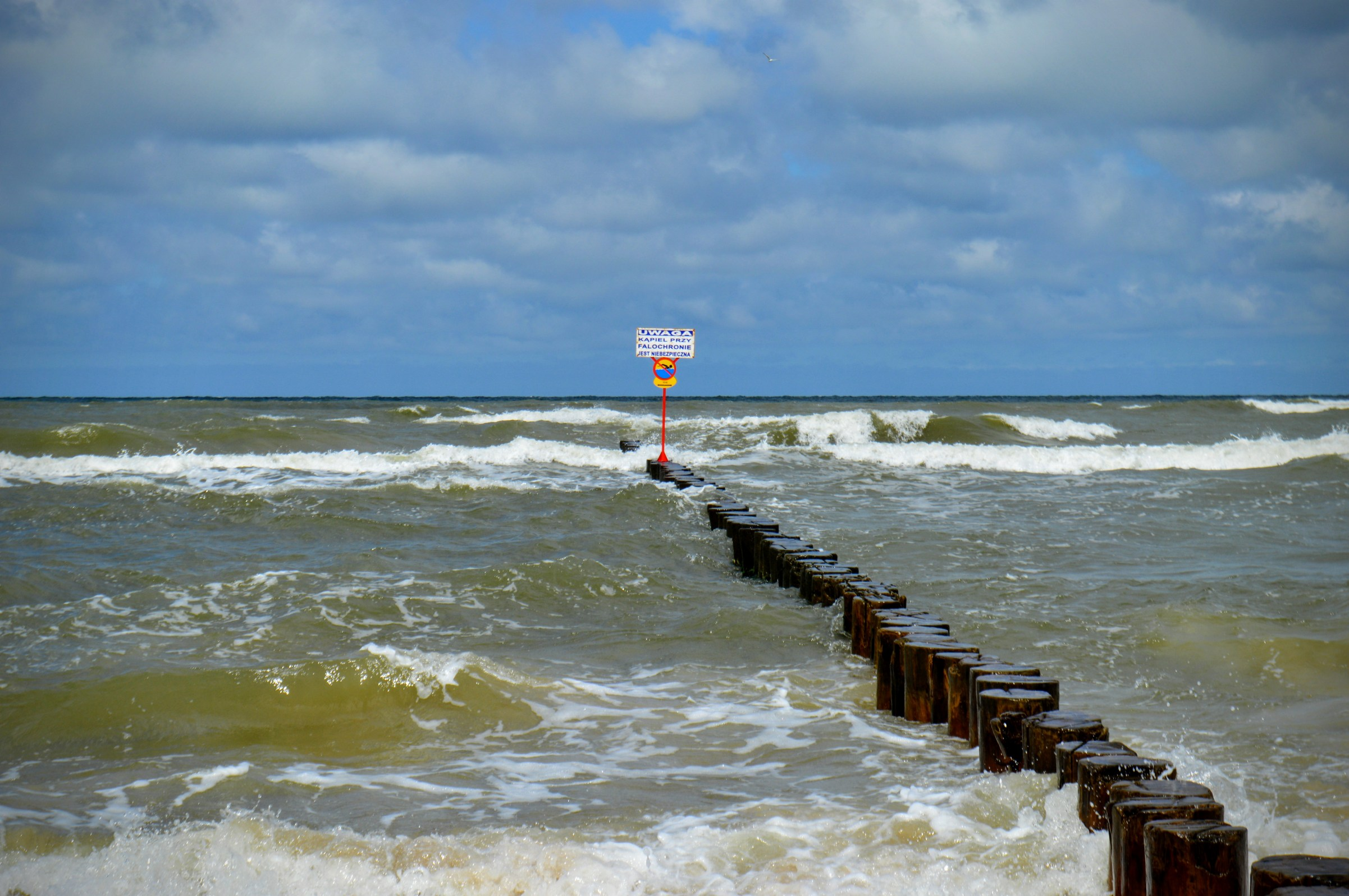 Breakwaters with a wooden deck in a stormy sea photo