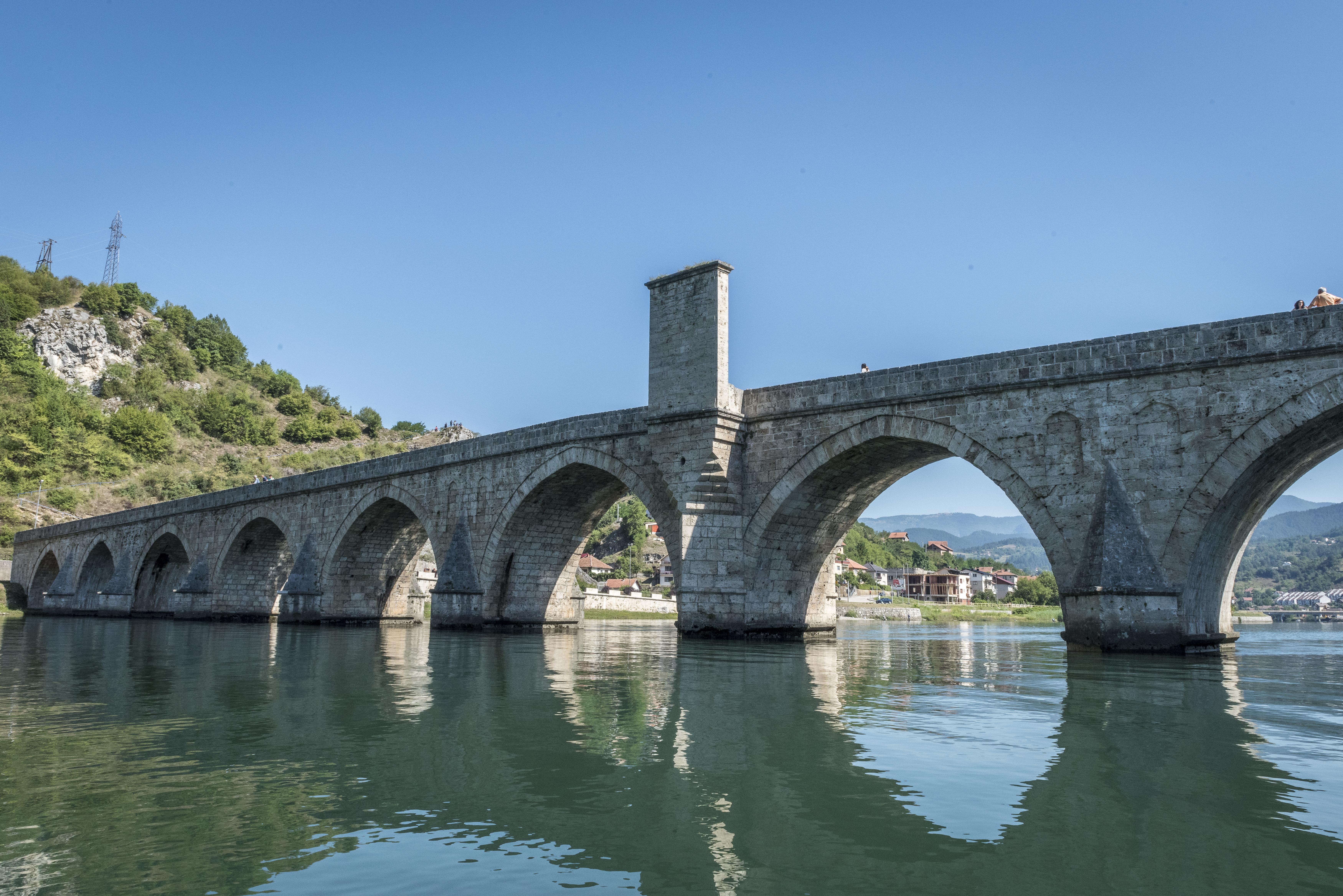 The famous bridge on the Drina River: Višegrad Bridge that the whole ...