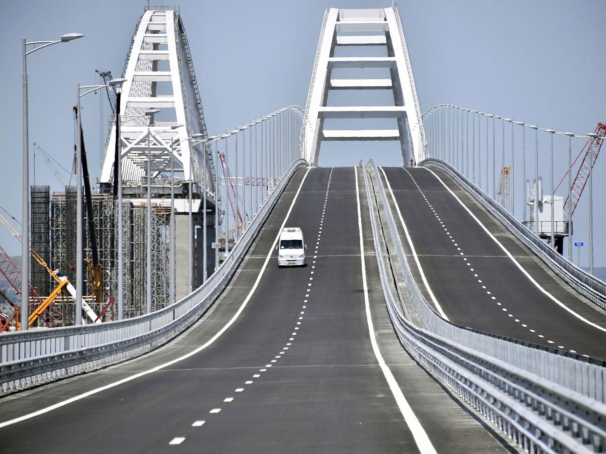 It's a real celebration!' Russia opens controversial 12-mile bridge ...