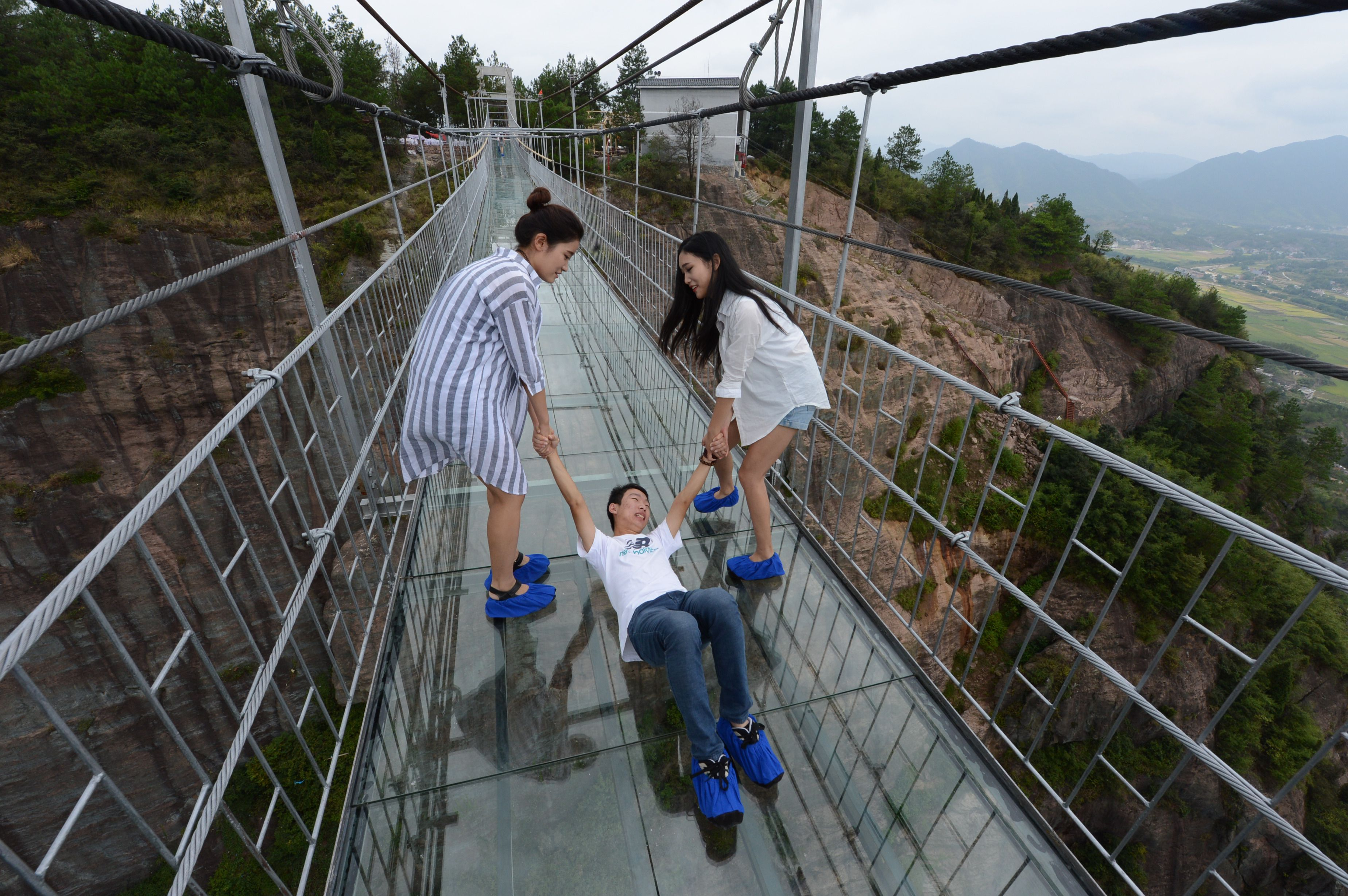 China dares you to cross its giant glass bridge | The Verge