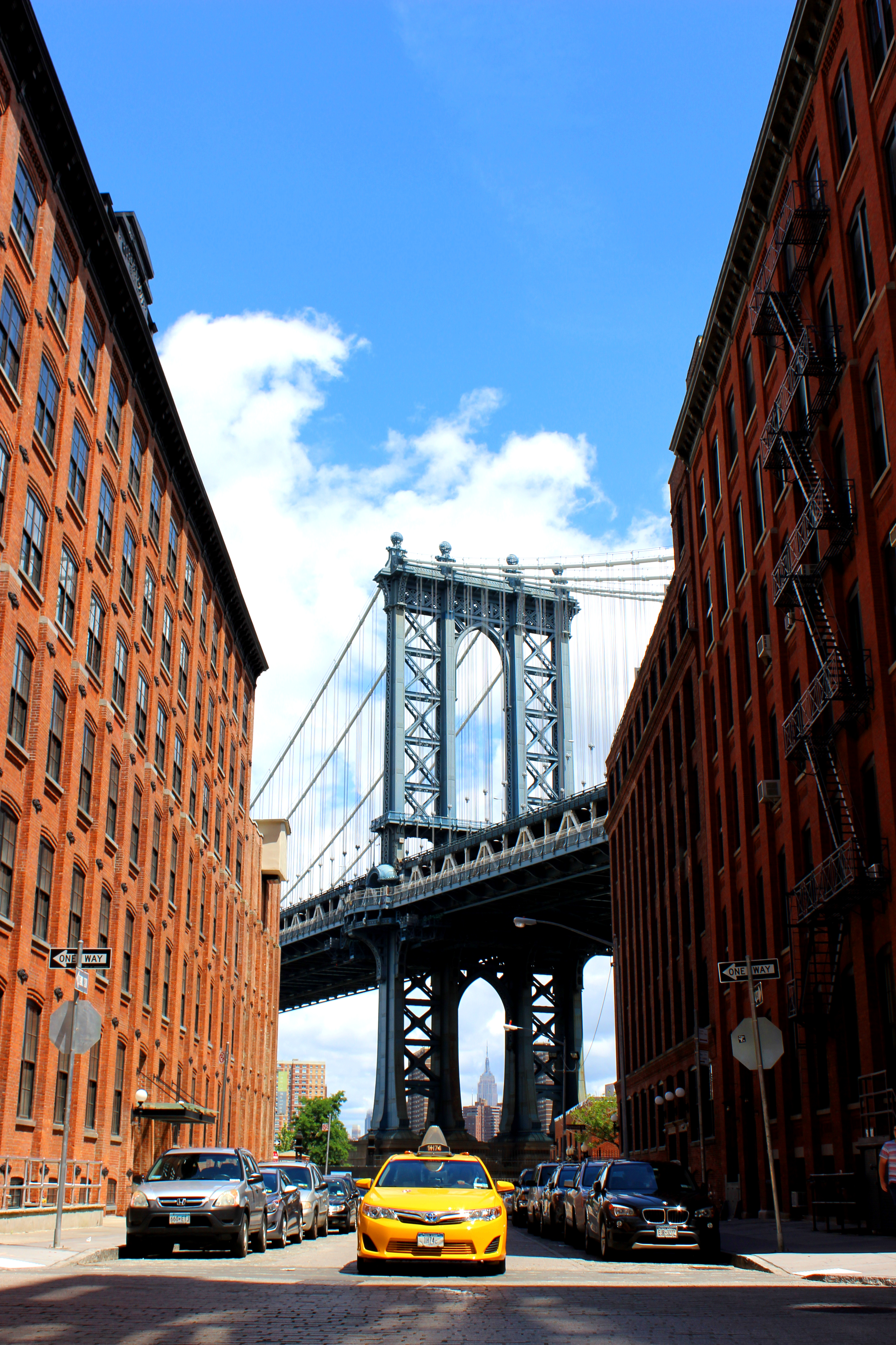 Bridge by two red brick buildings photo