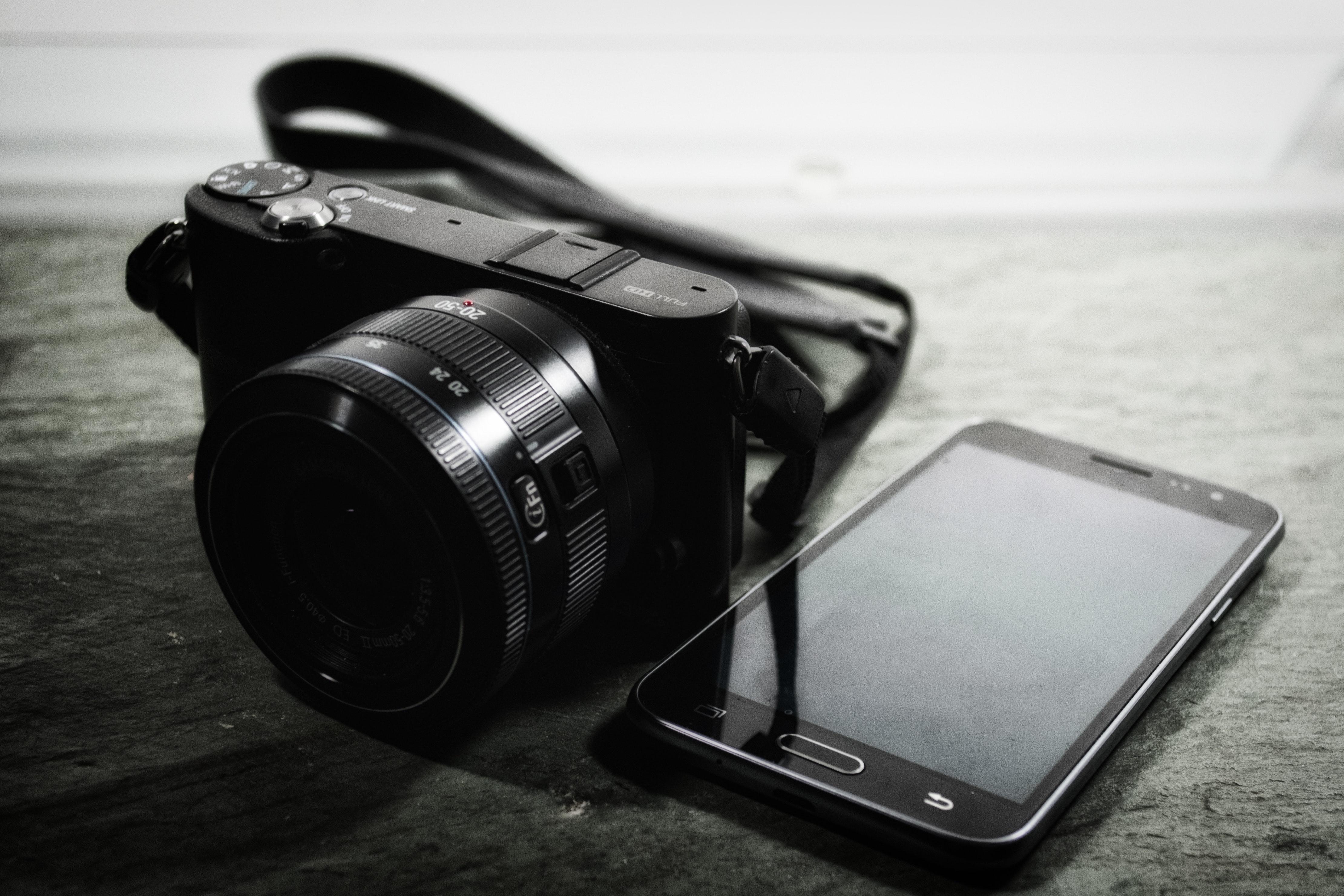 Bridge camera beside samsung smartphone photo