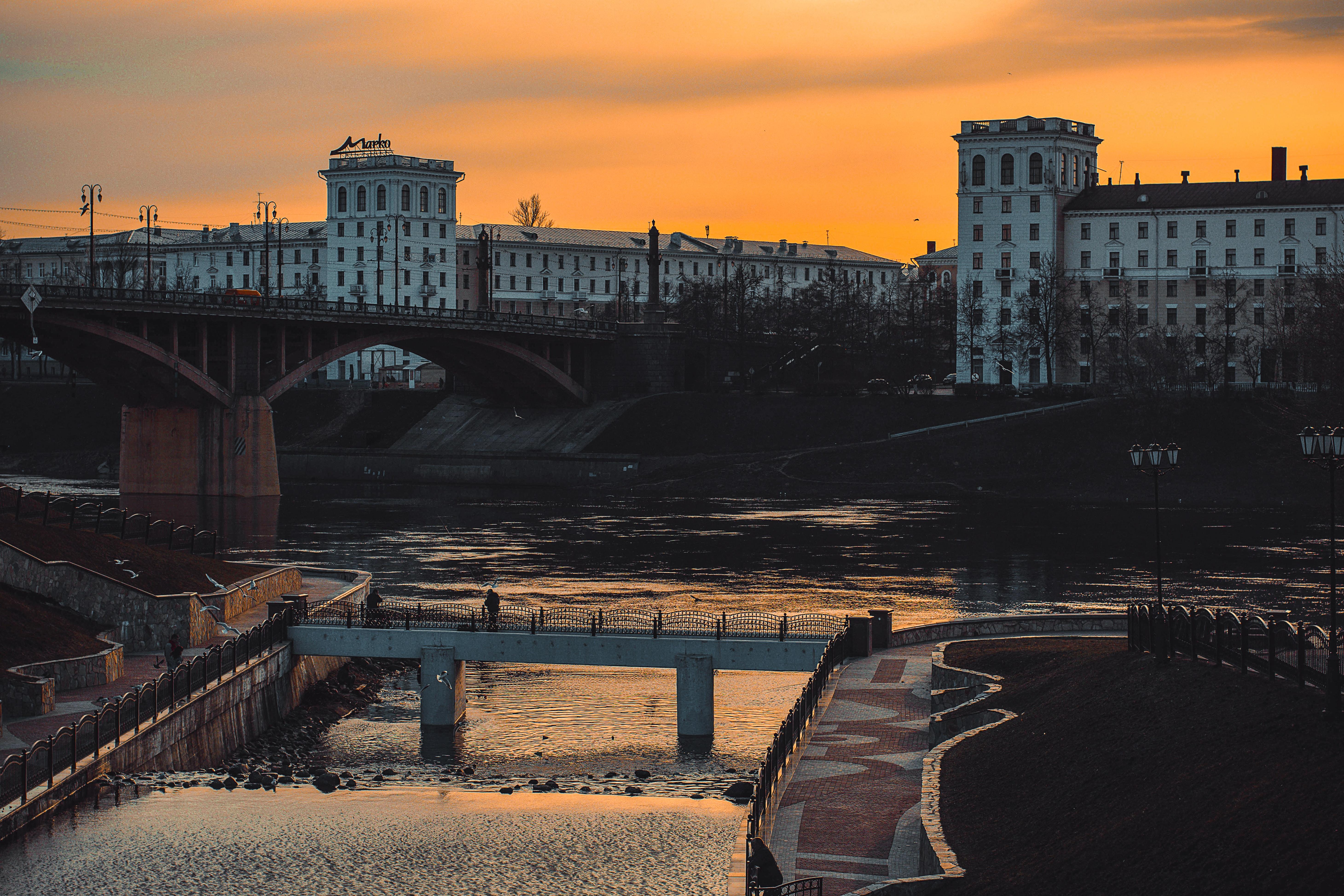 Bridge near high-rise building photo