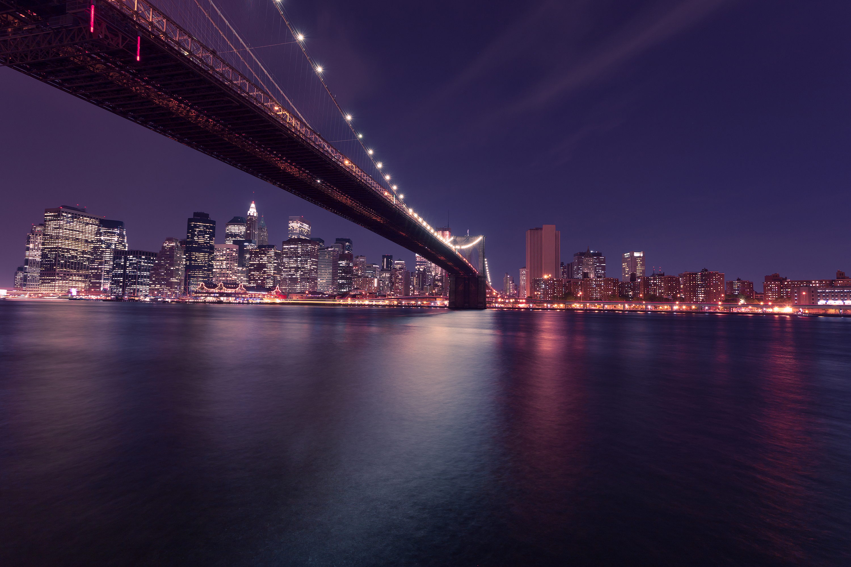 Bridge to city at night with lights photo