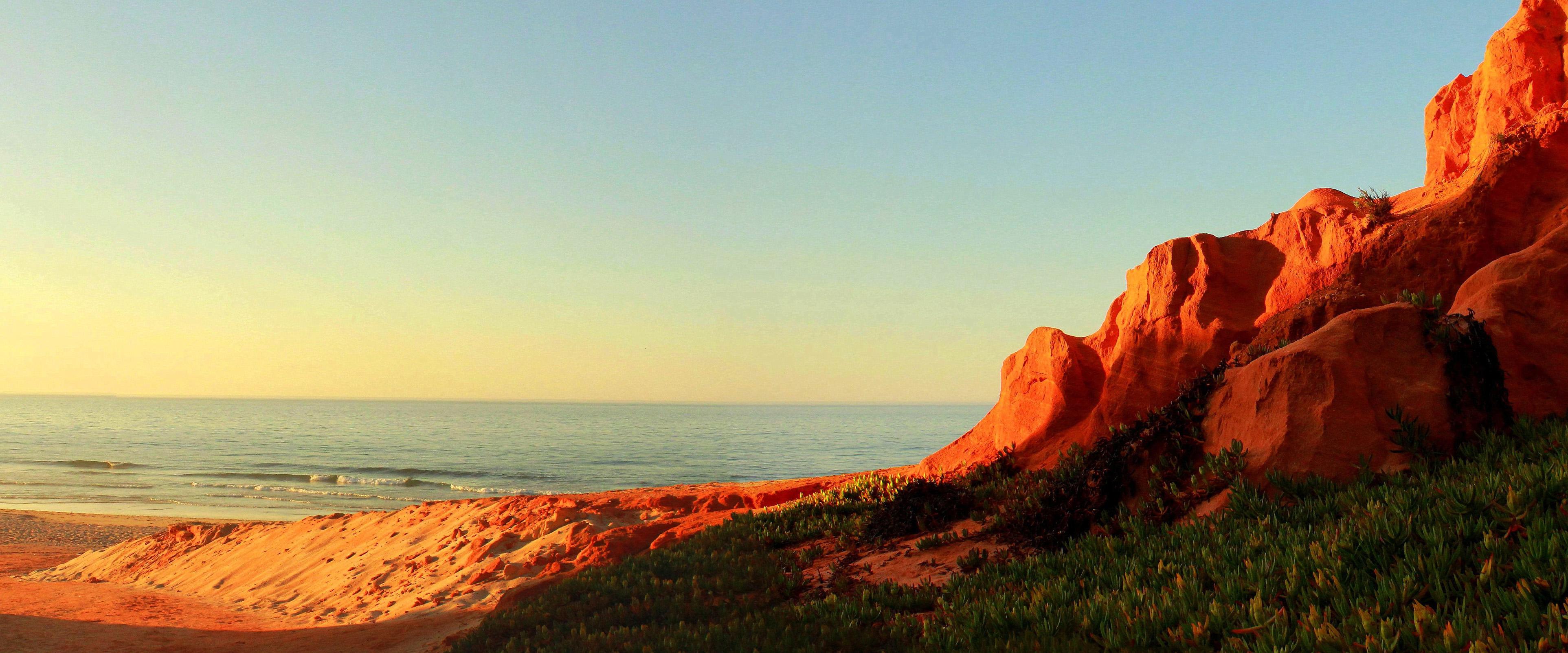 Bright sandstone coastal cliffs photo