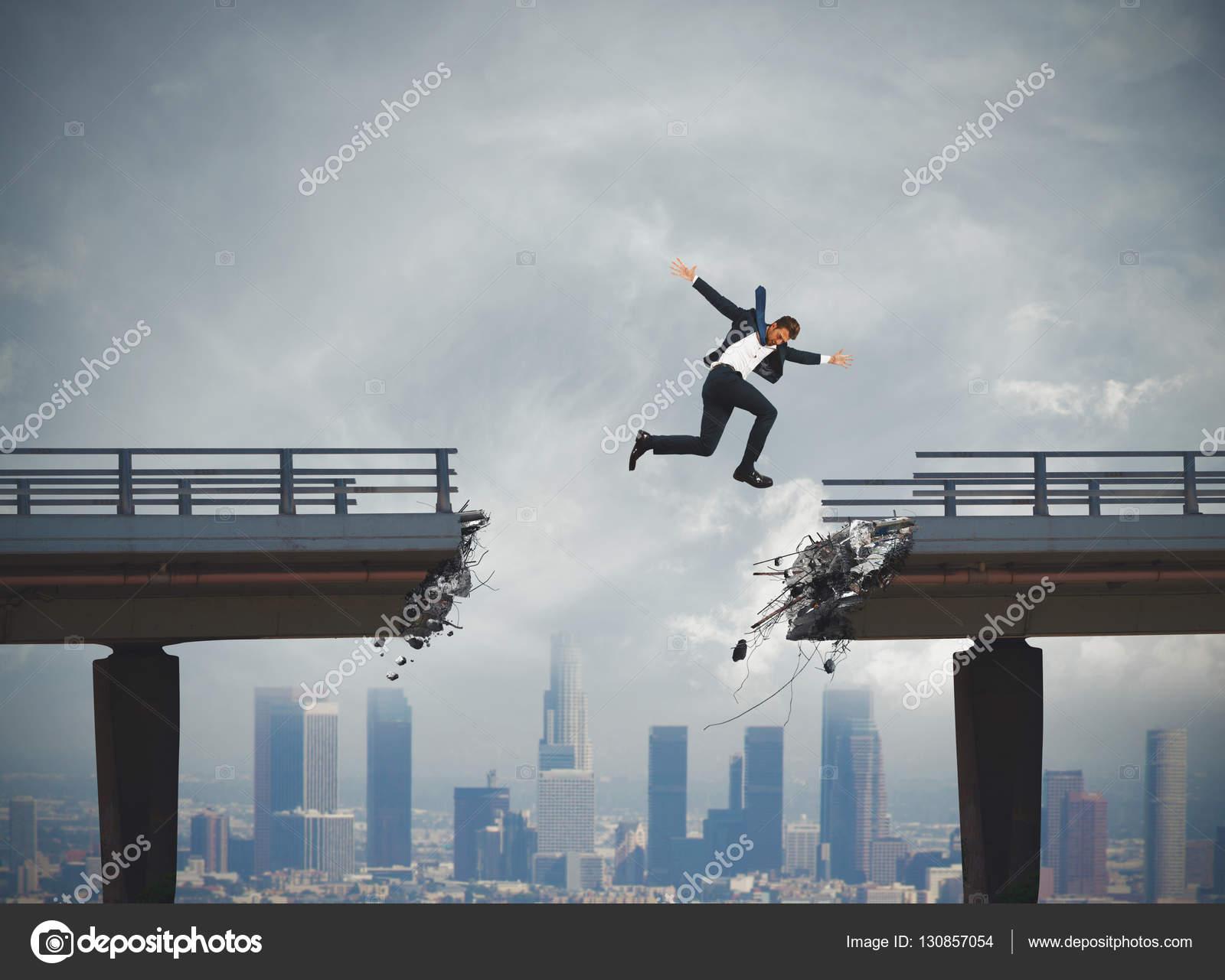 Businessman passes a broken bridge — Stock Photo © alphaspirit ...