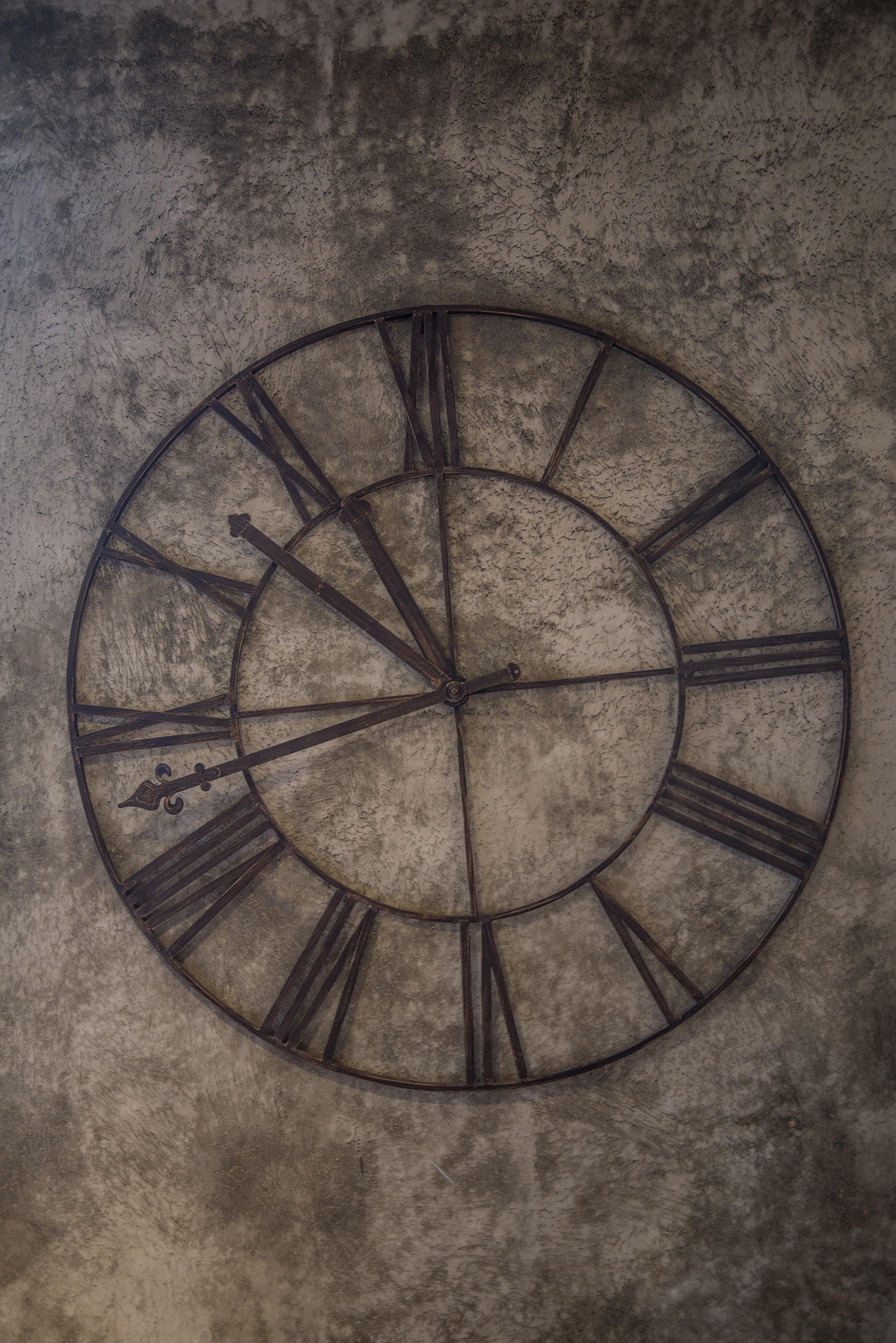 Brown analog wall clock at 11:48 photo