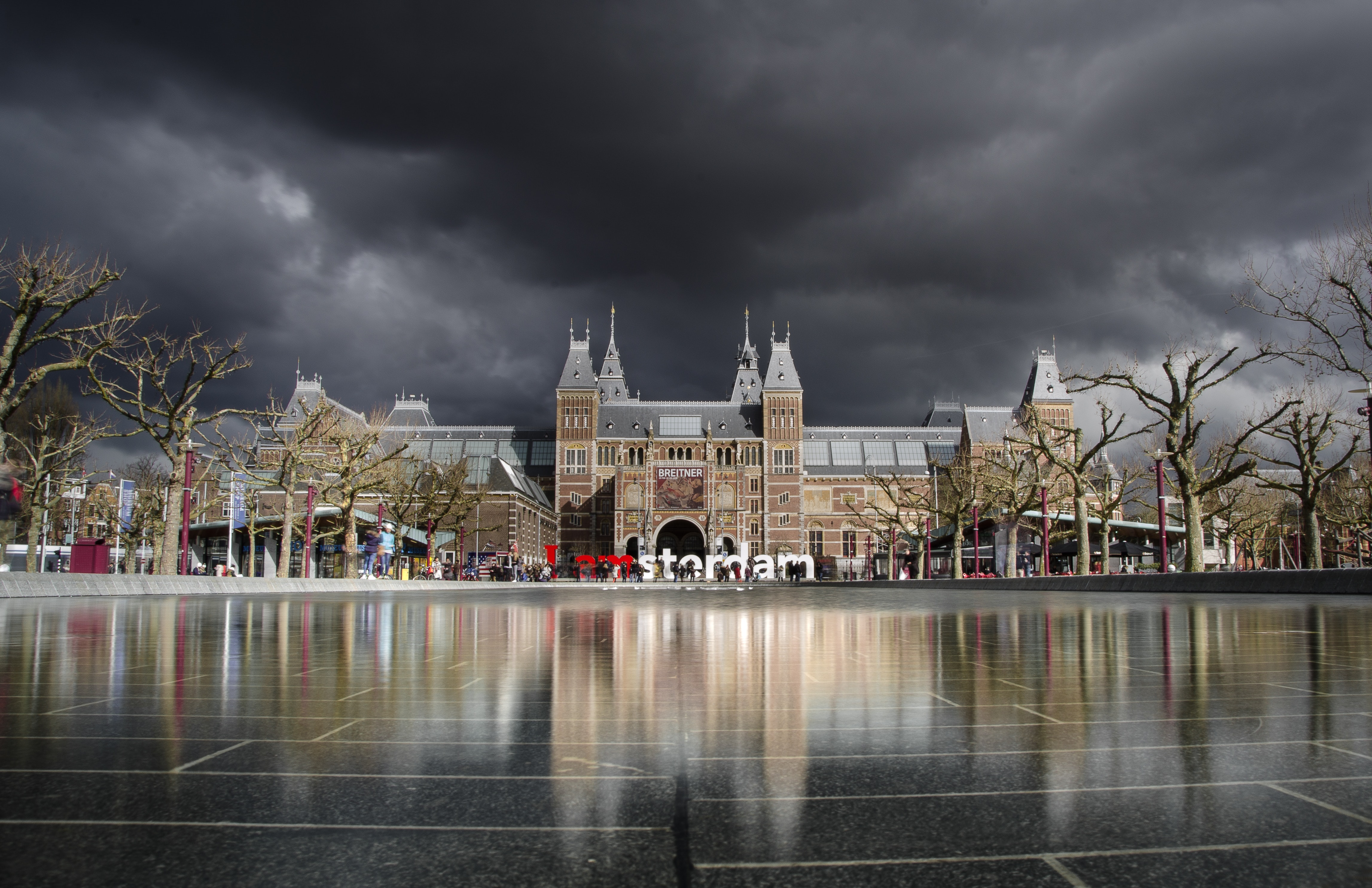 Brown and Grey High Rise Building Beside Leafless Trees during Dark Skies, Amsterdam, Architecture, Building, Dark clouds, HQ Photo