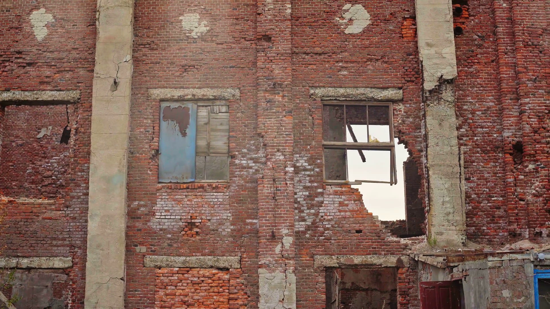 The camera zooms in on old red brick inner-city school building with ...