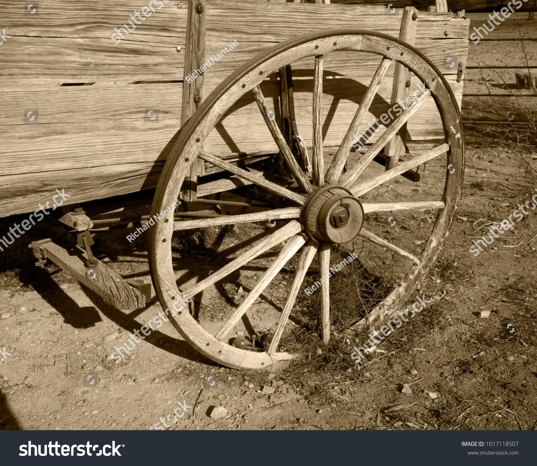 Old Carriage Wheel Sepia Stock Photo (Royalty Free) 1017118507 ...