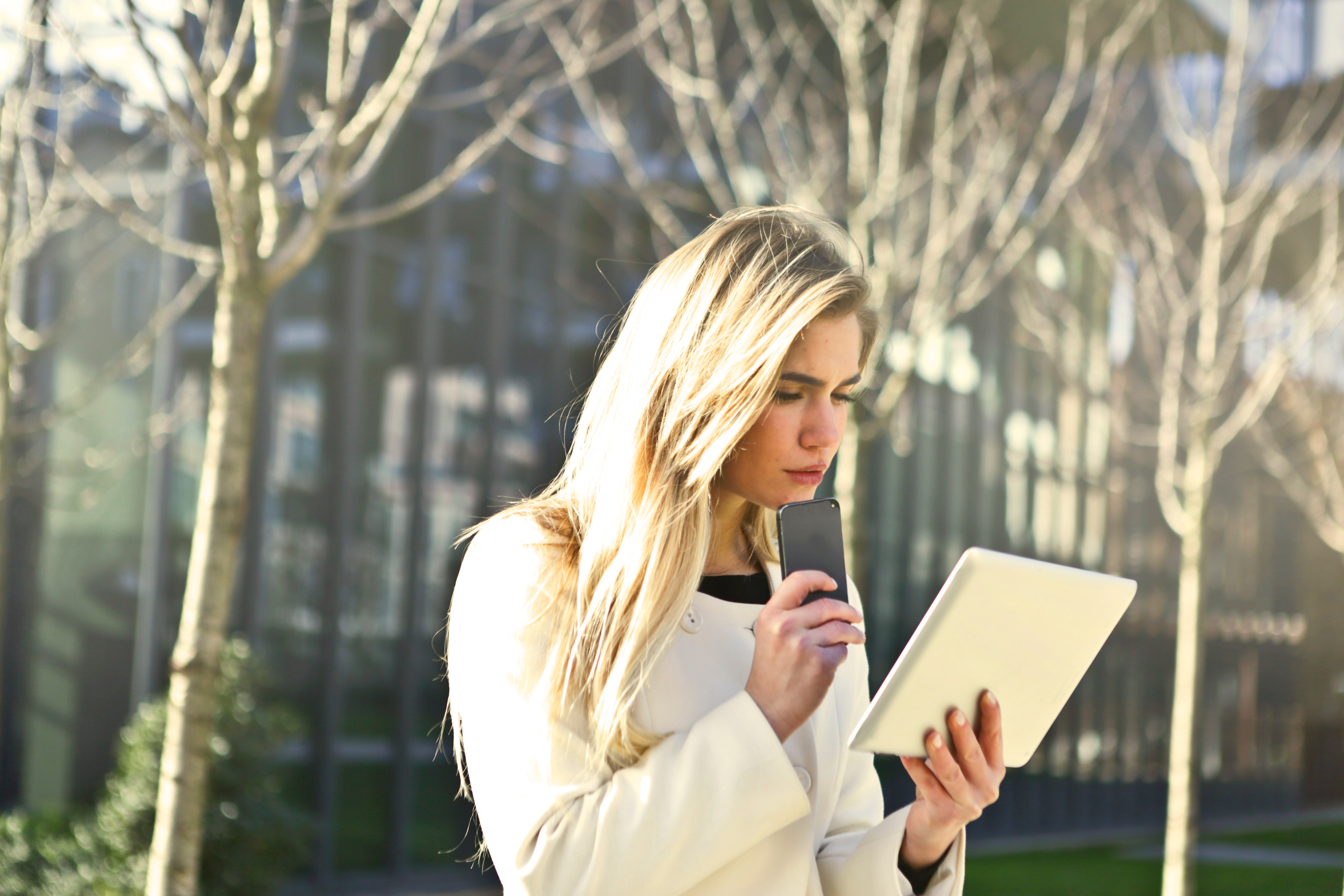 Brown-haired Woman Holding a White Wireless Device, Park, Young, Work, Woman, HQ Photo
