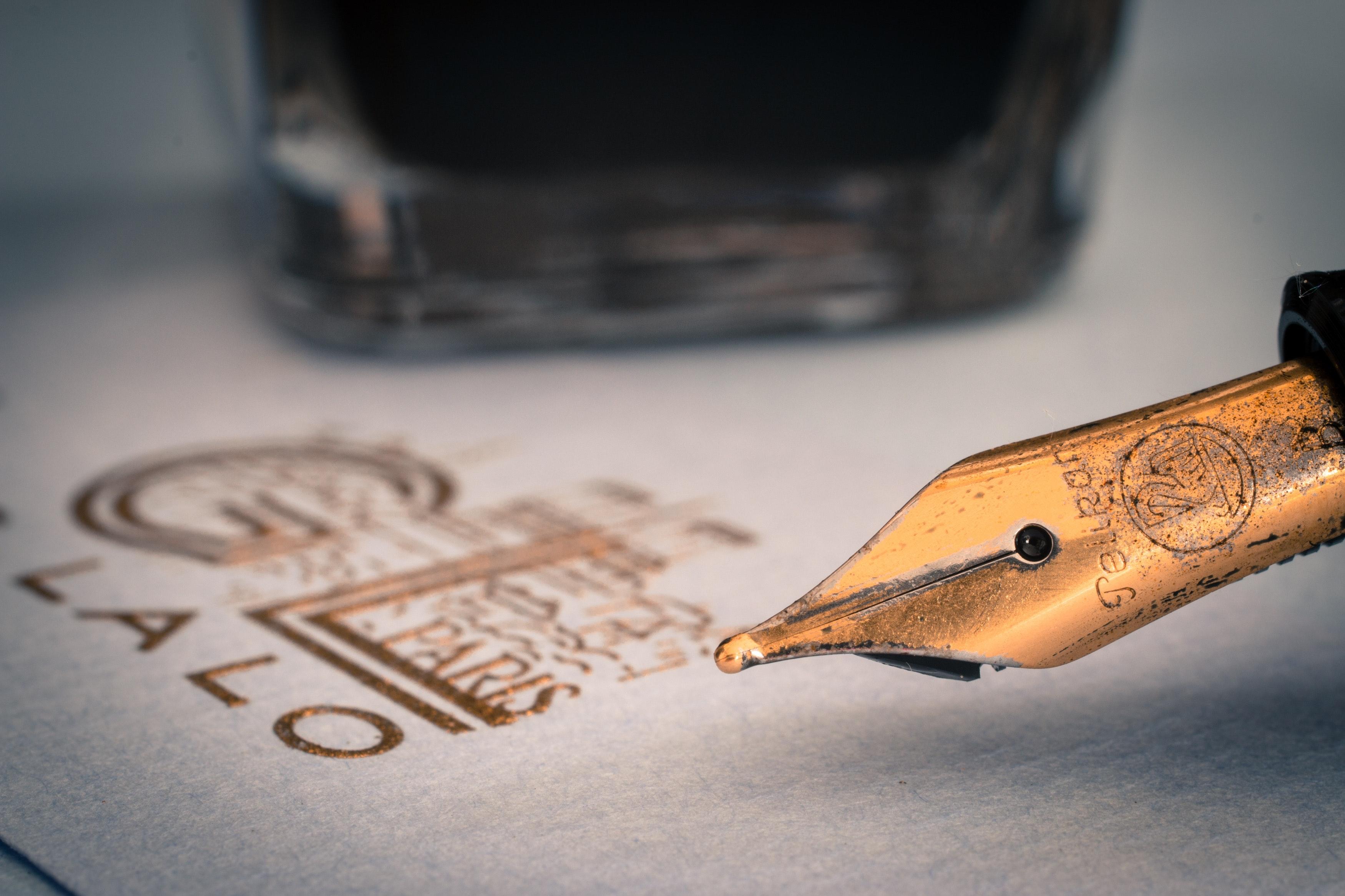 Brown ink pen photo