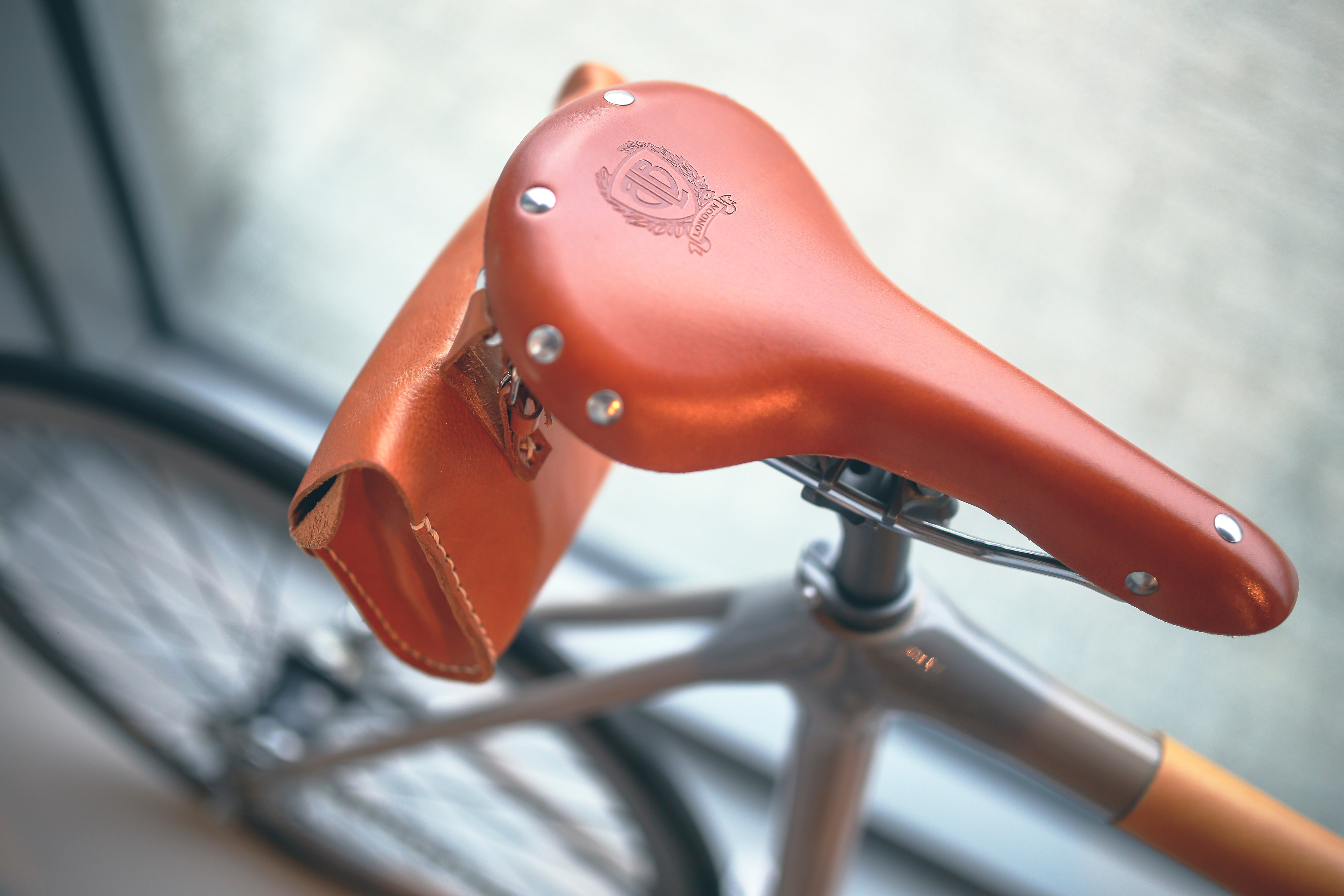 Brown leather bicycle saddle photo