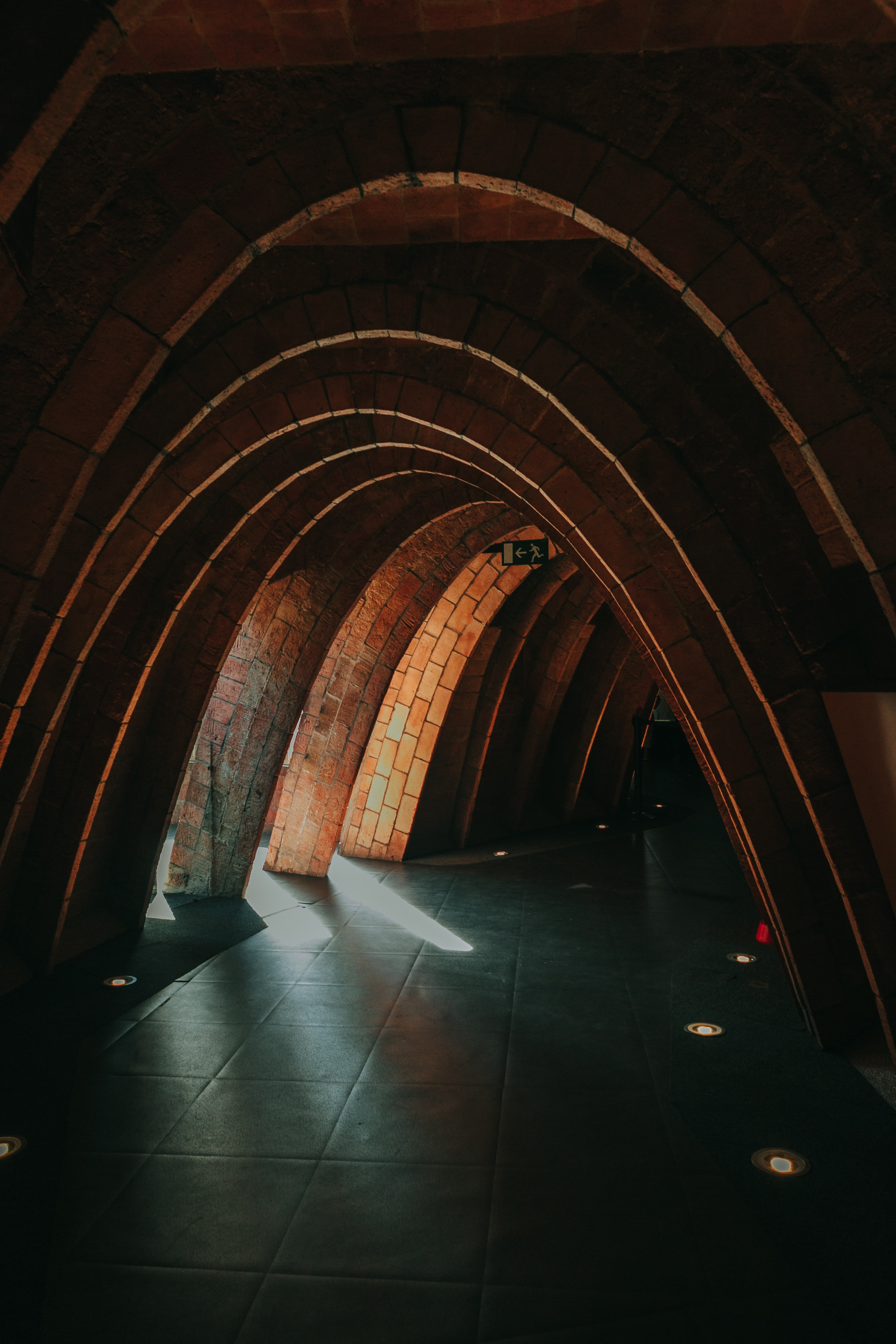 Brown multi-arc green-floored tunnel photo