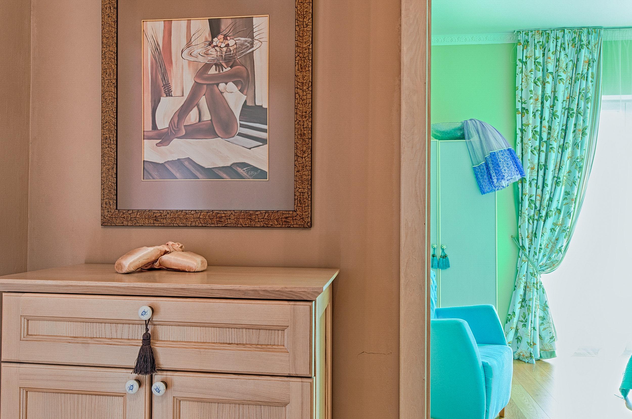 Brown wooden cabinet near doorway photo