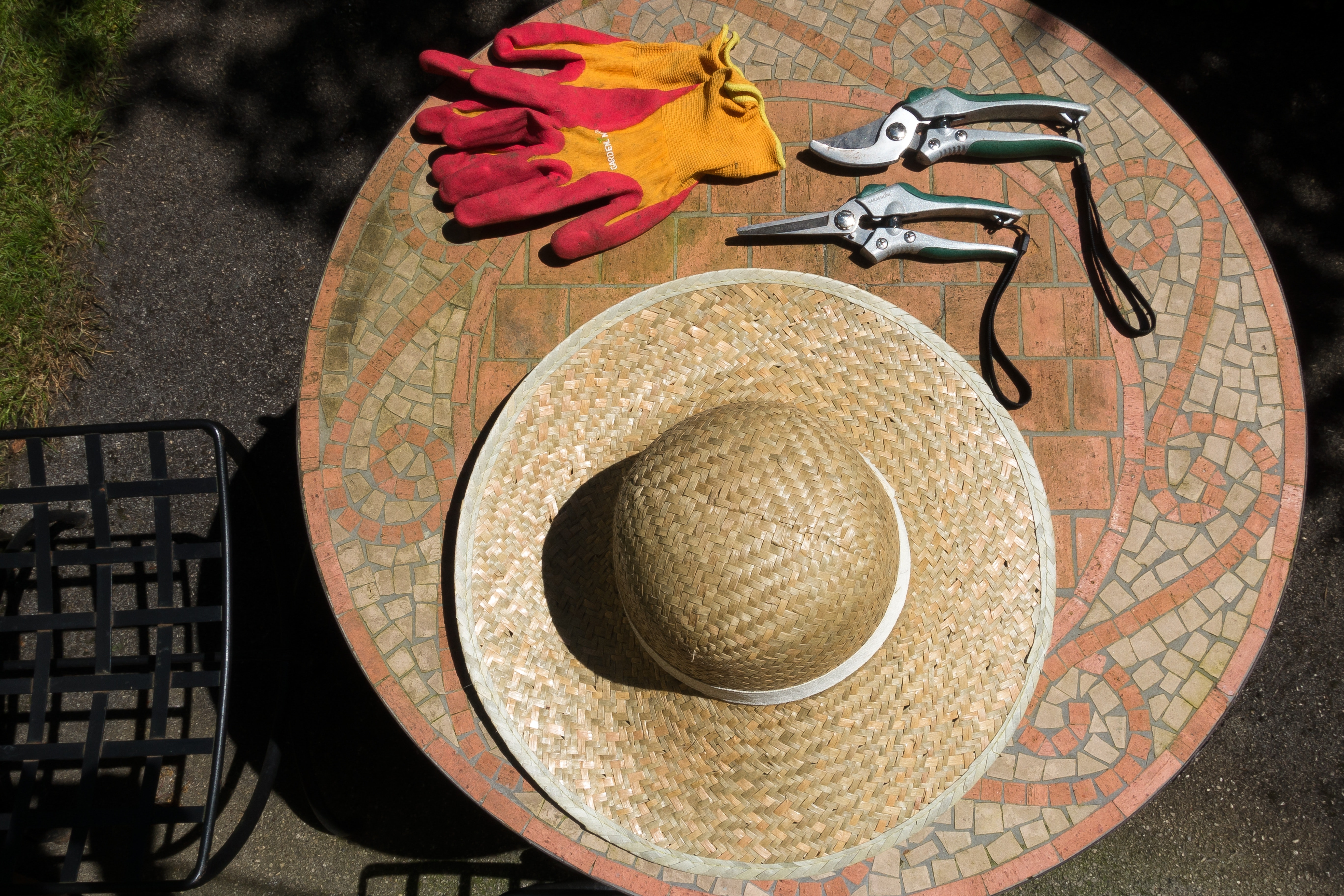 Brown woven hat over brown wooden round table top photo