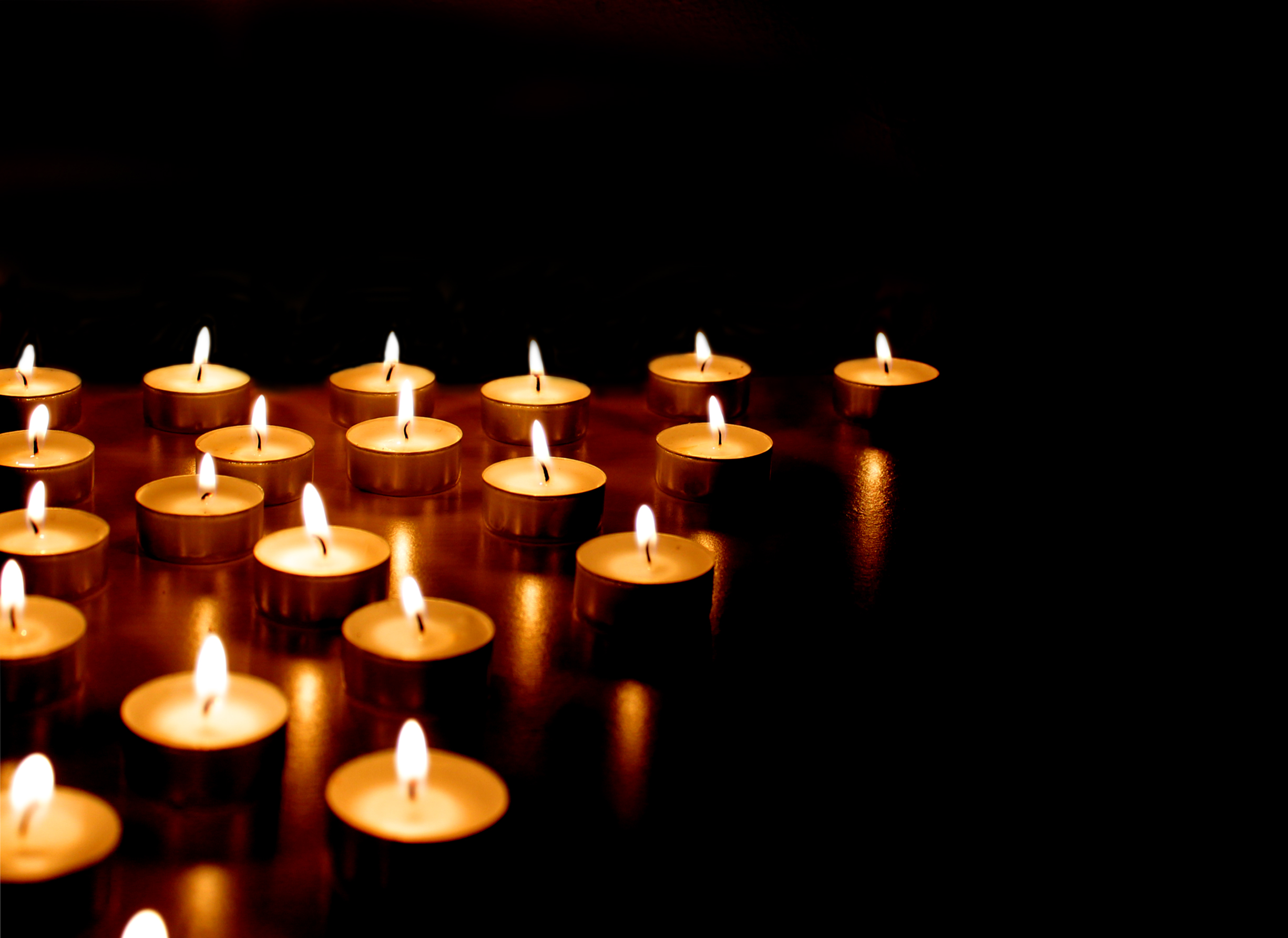 Burning candles on black background photo