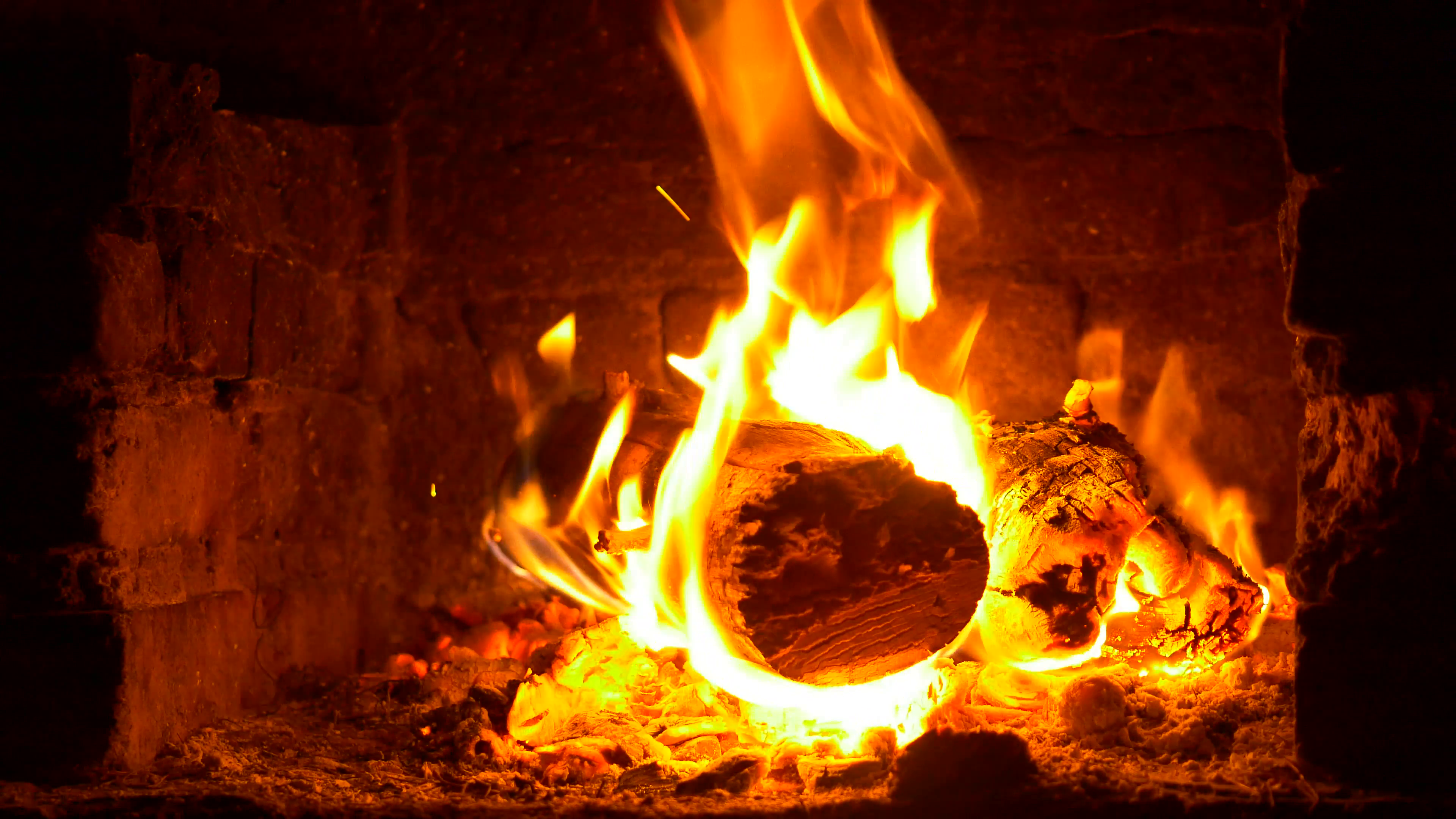 A warm fire in a chimney. 4K. Burning wood in the fireplace and the ...