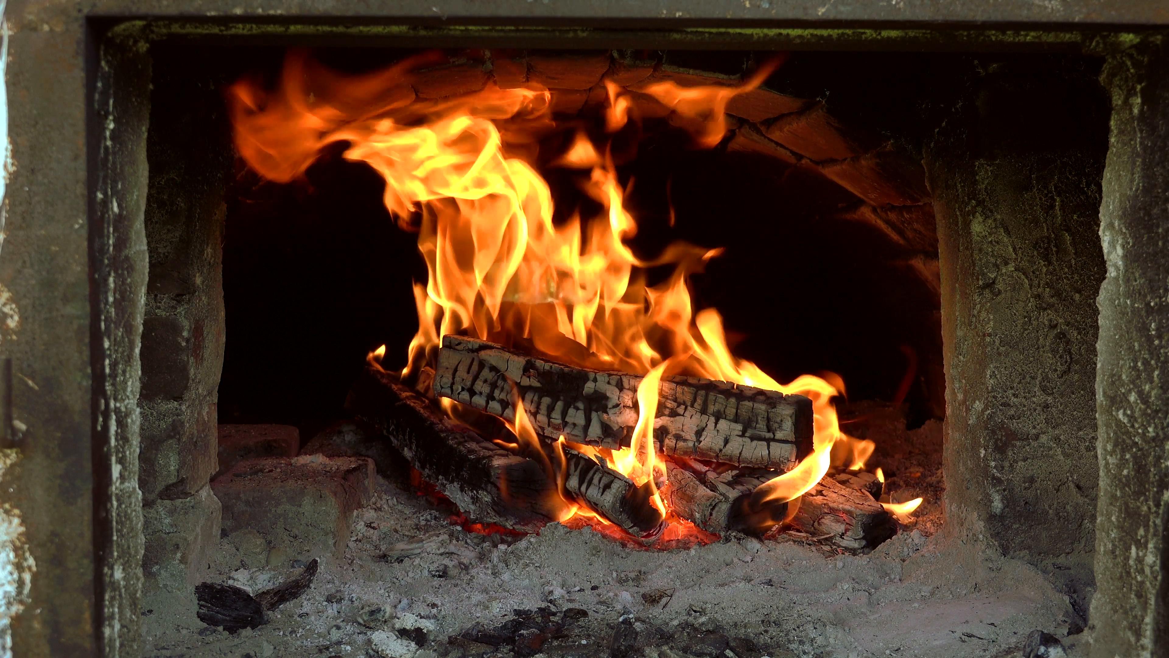 ULTRA HD 4K Close up yellow light wood burning fire flame burn glow ...