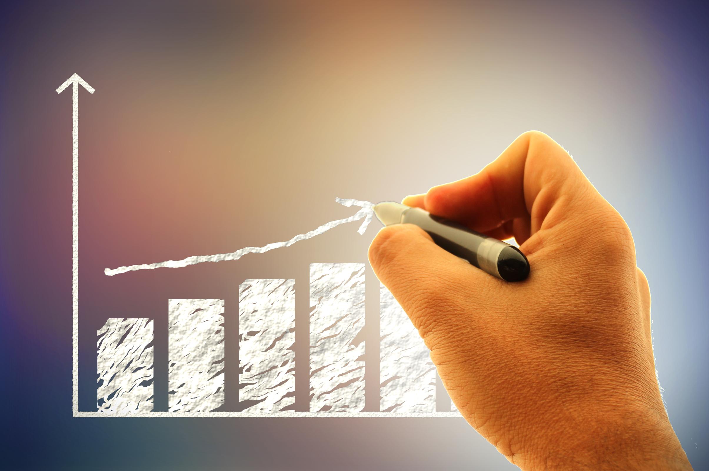 Businessman drawing a financial graph photo