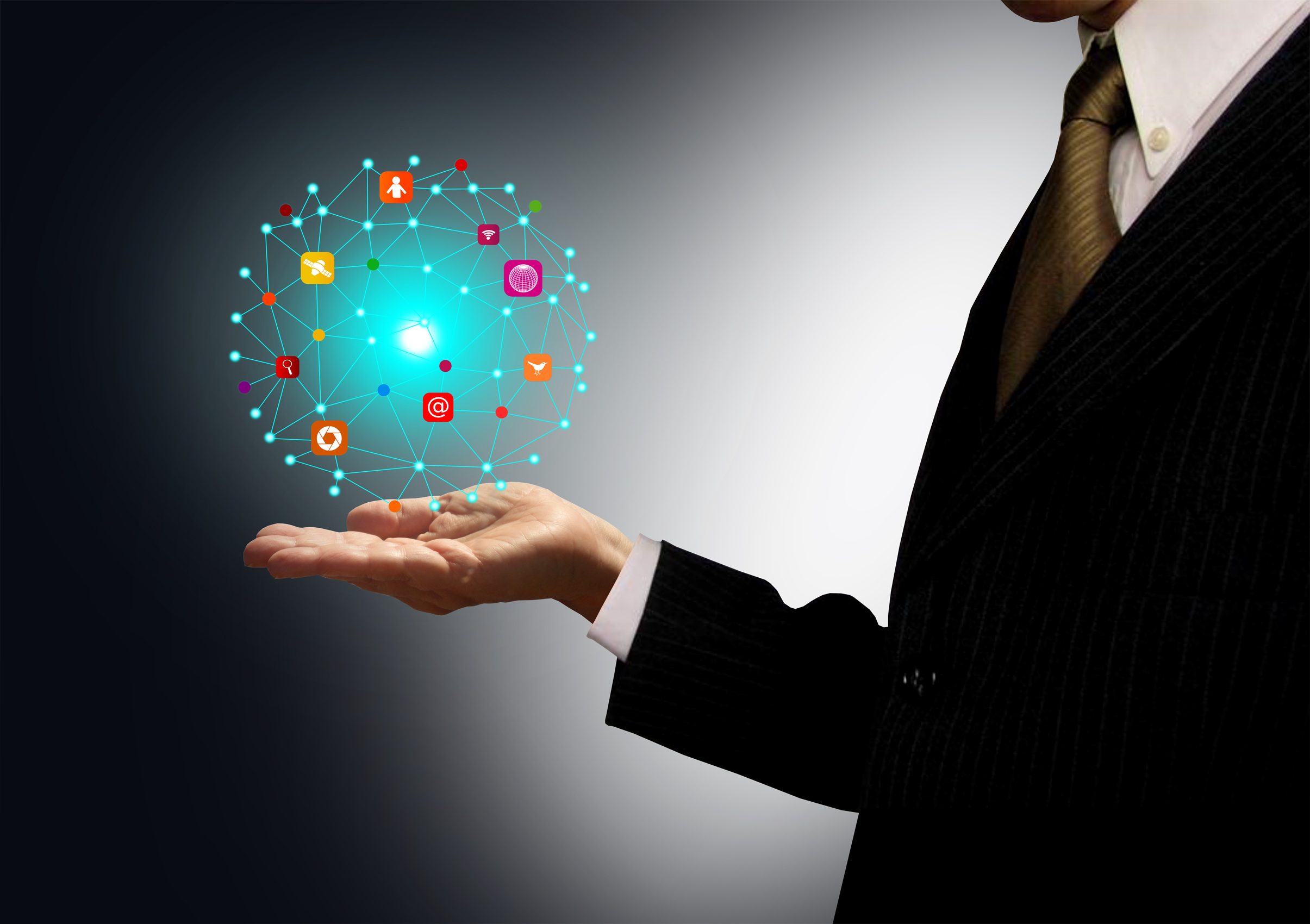 Businessman holding a ball with information technology icons photo