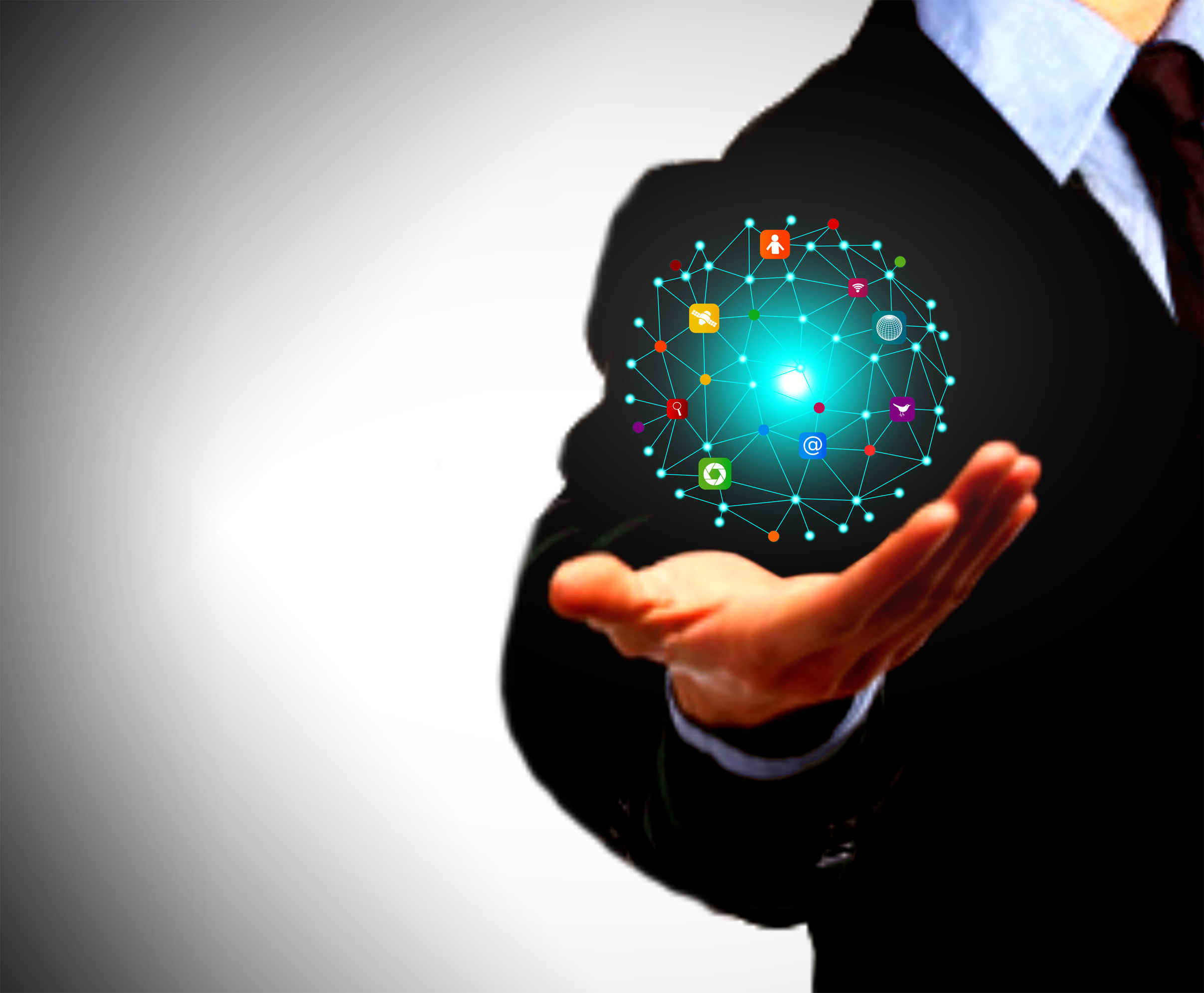 Businessman holding a globe with information technology icons photo