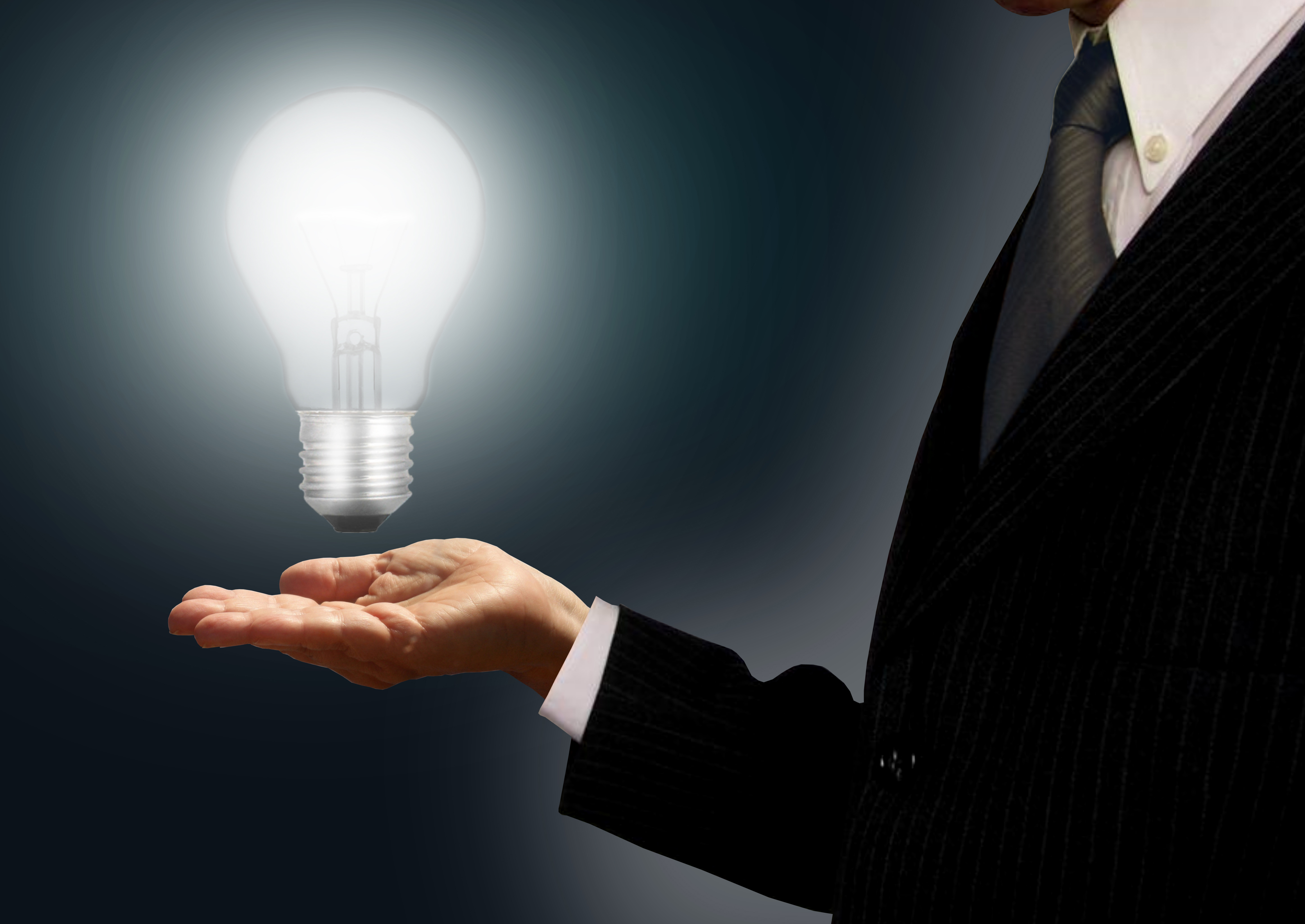Businessman holding a lightbulb - ideas and creativity concept photo