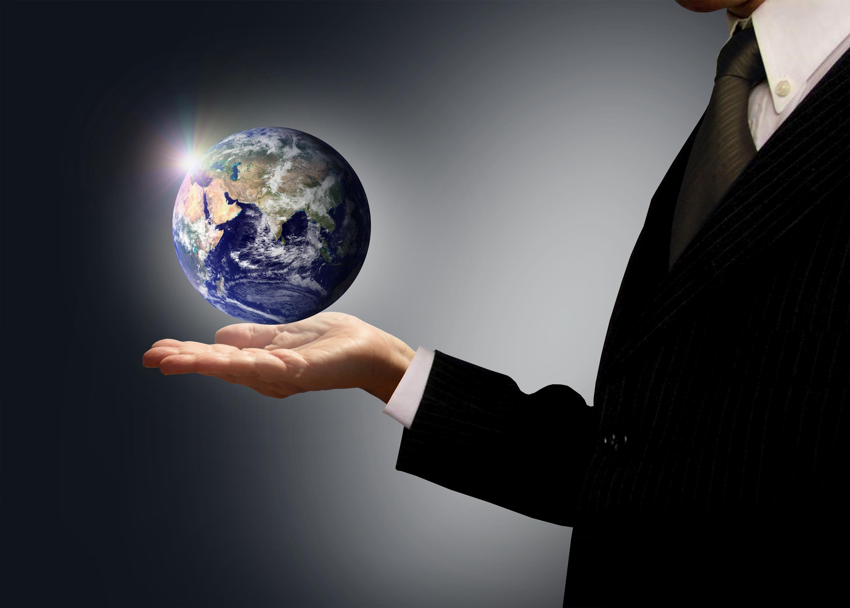 Businessman holding earth globe - globalization concept photo
