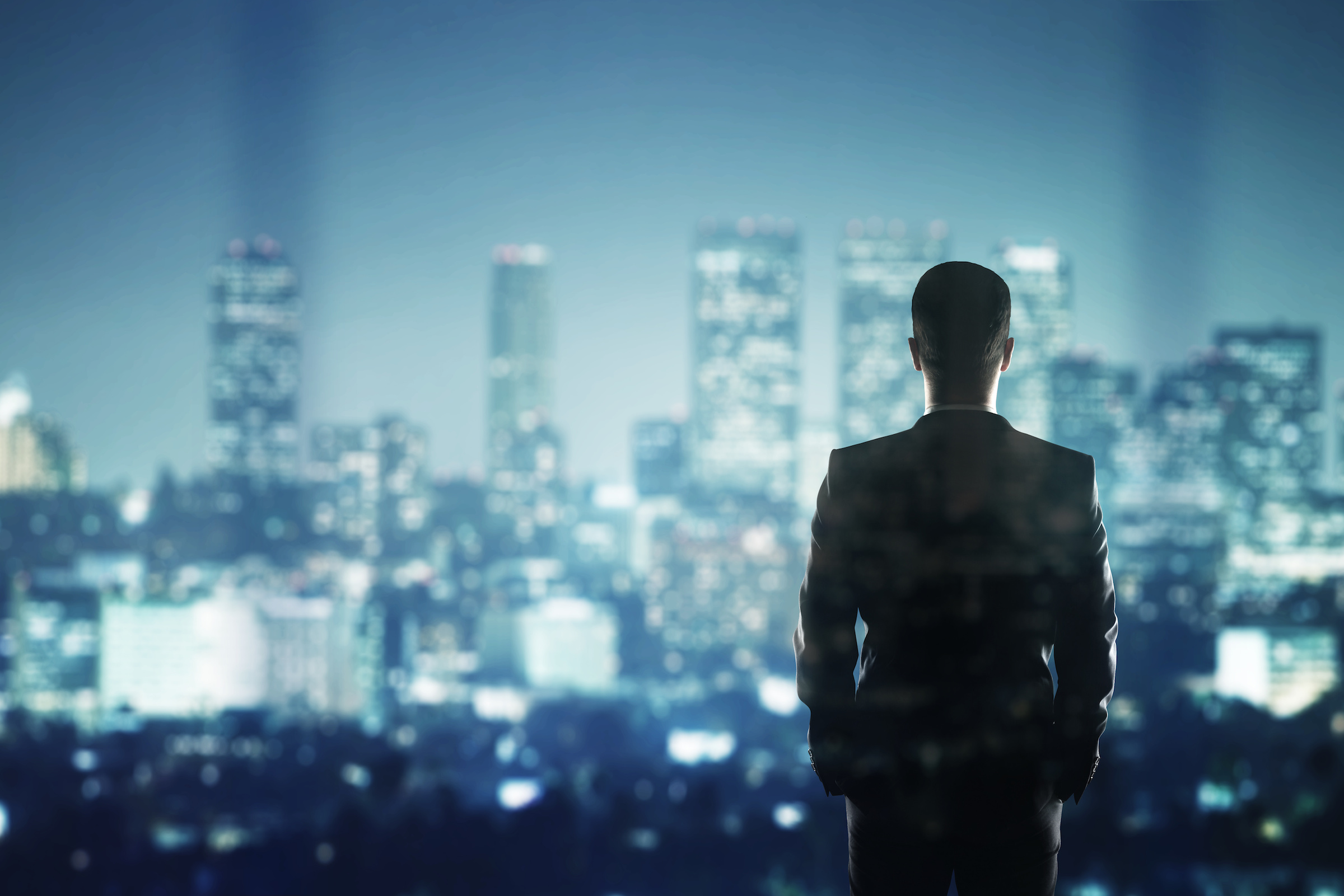 businessman looking to city | Adam Shaw CPA