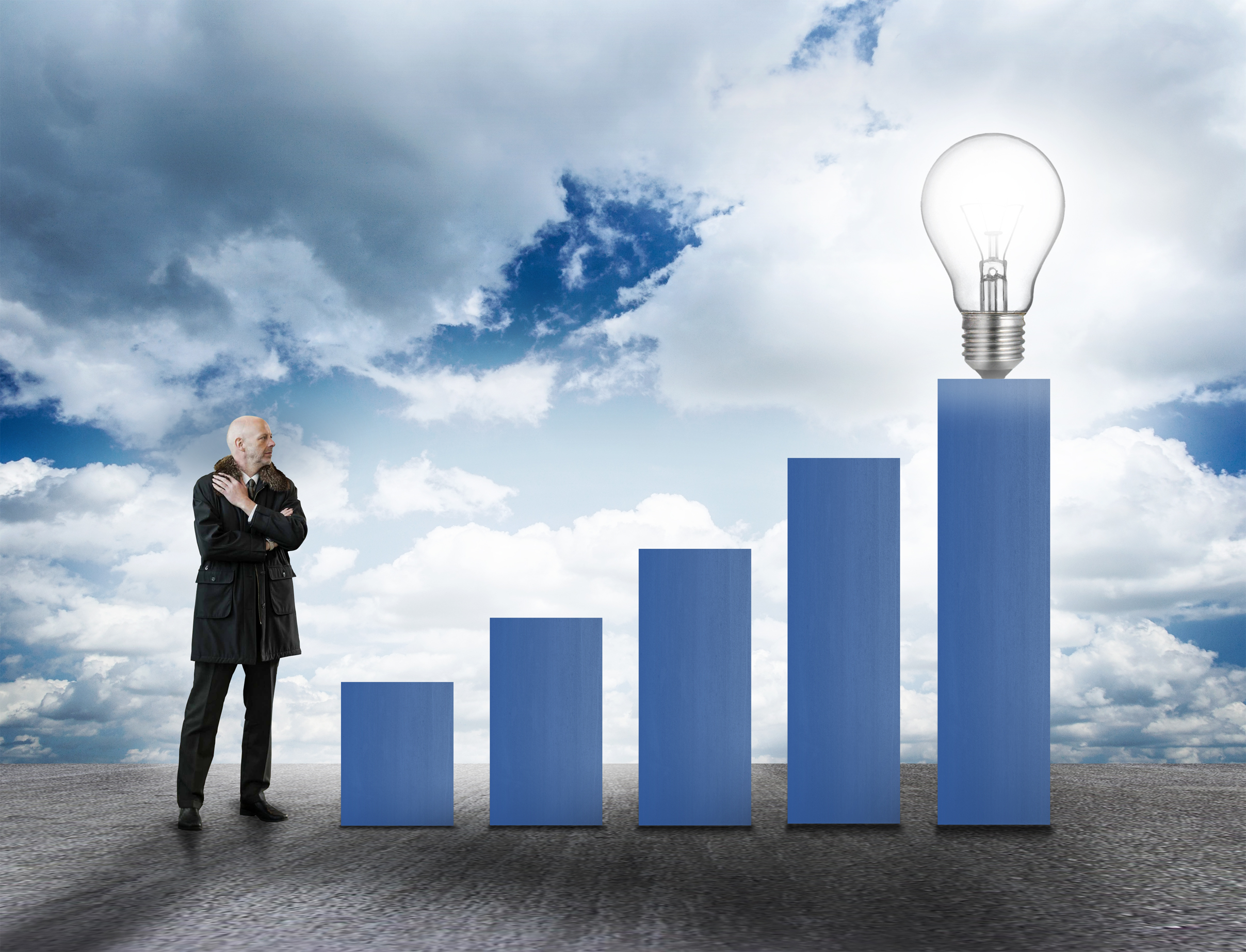 Businessman with bar chart and lightbult - asset growth concept photo