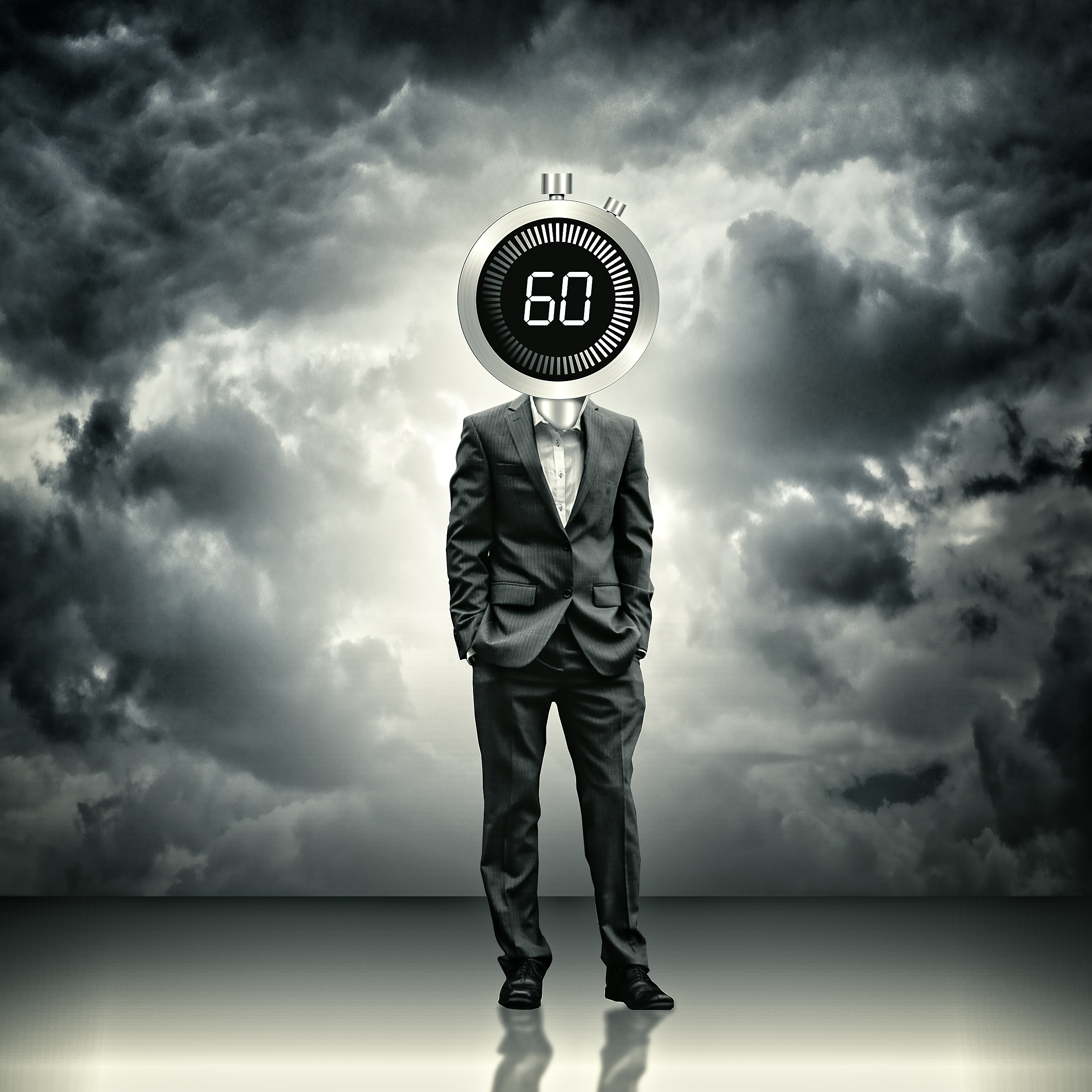 Businessman with stopwatch head - time concept photo