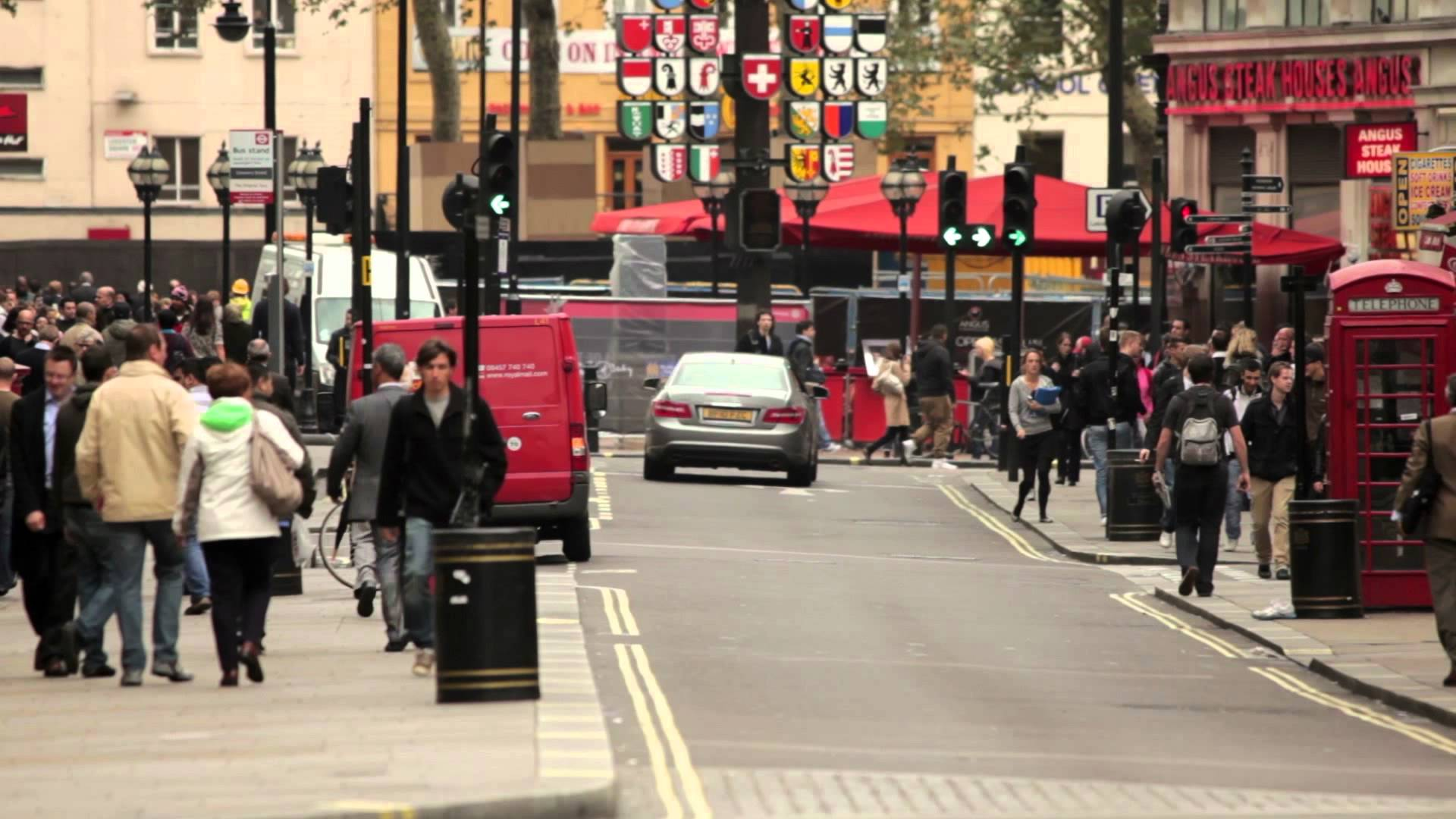 People and traffic on a busy street in London - YouTube