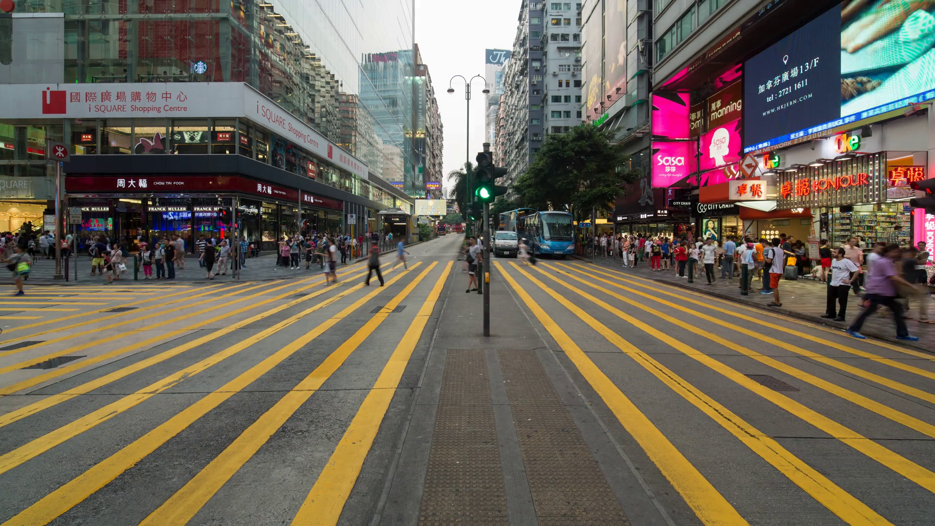 Time lapse of pedestrians and traffic at a busy road crossing in ...