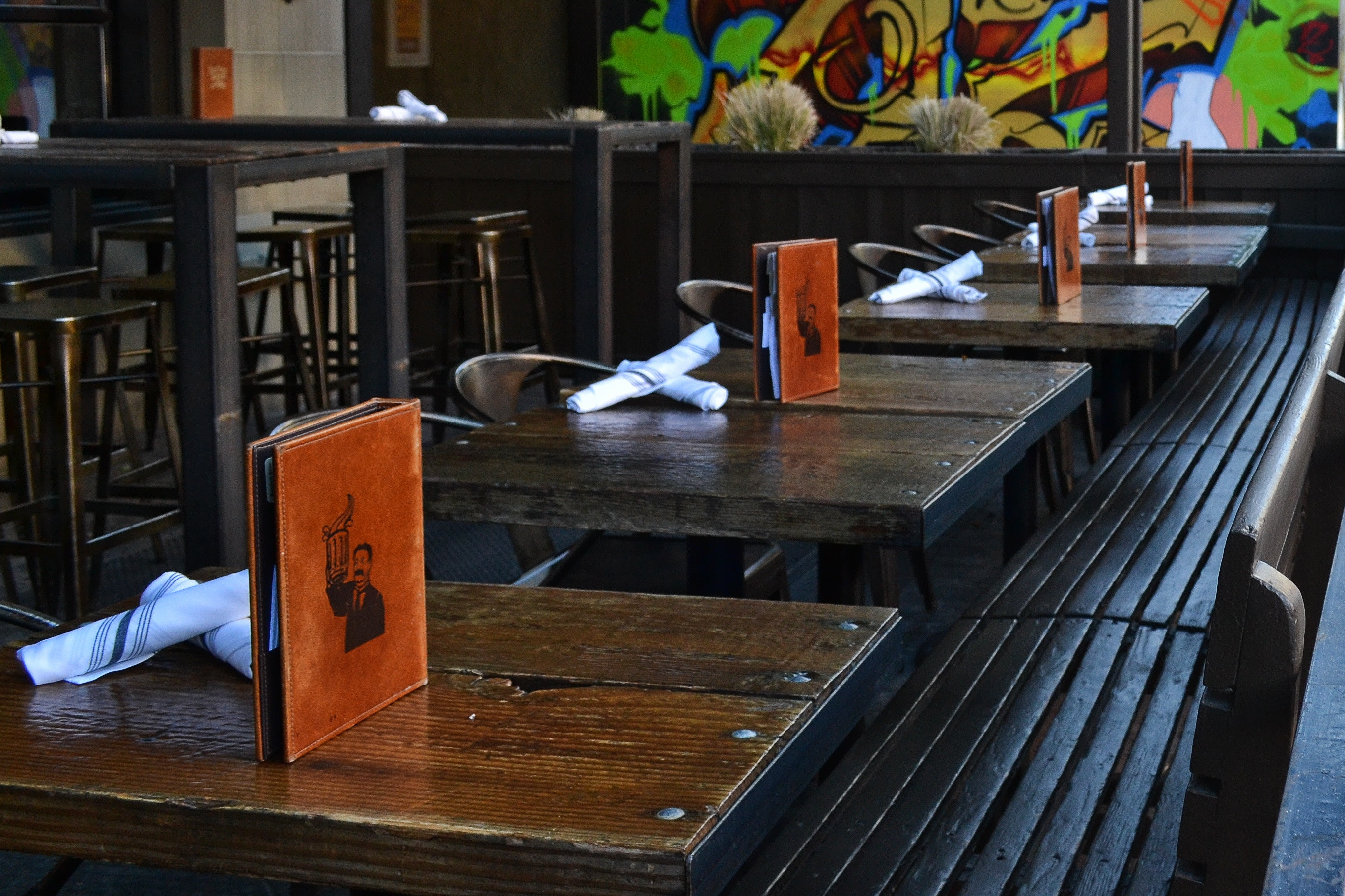 Cafe with dark wooden furniture and leather menus on tables photo