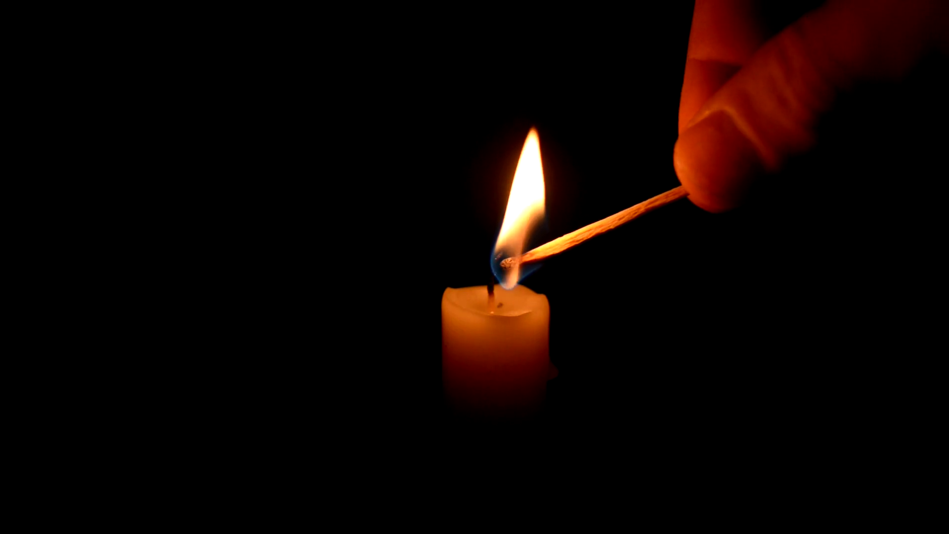 single candle burning on dark Stock Video Footage - Videoblocks
