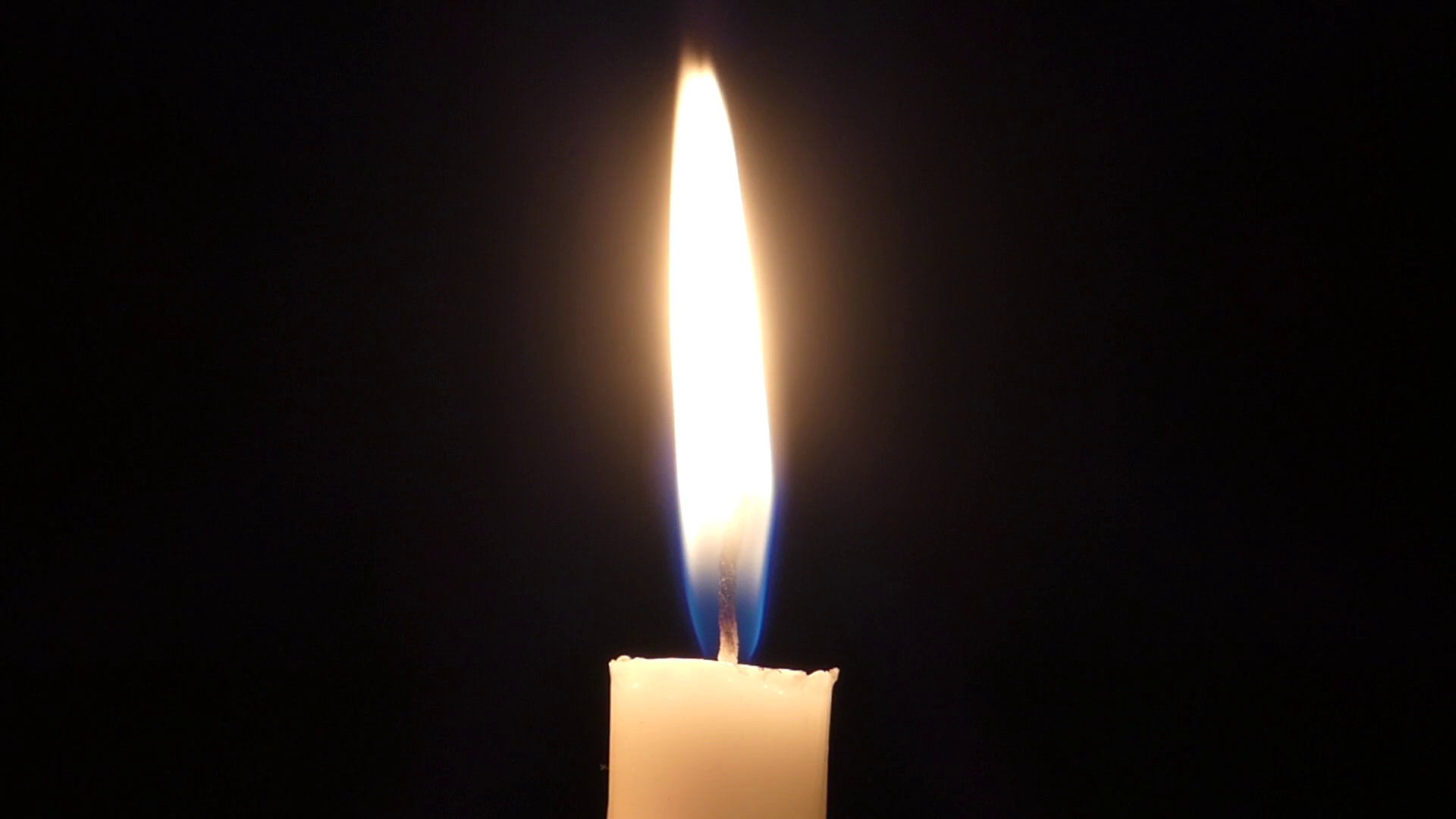 a Lit Candle Flame Blinking at Night. Stock Video Footage - Videoblocks