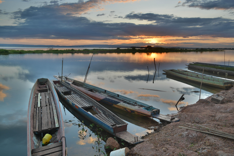 Canoe on seashore during sunset photo