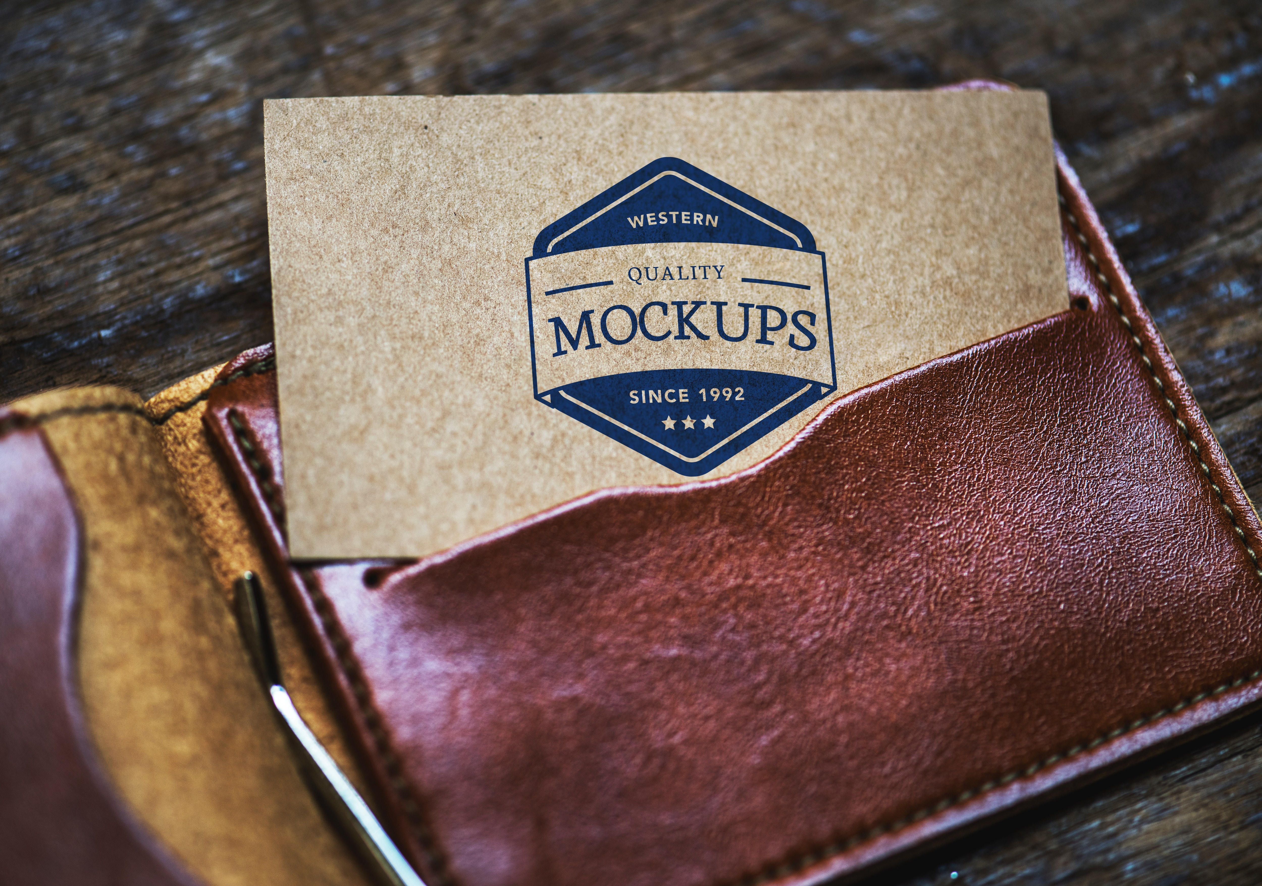 Card on brown leather bifold wallet photo