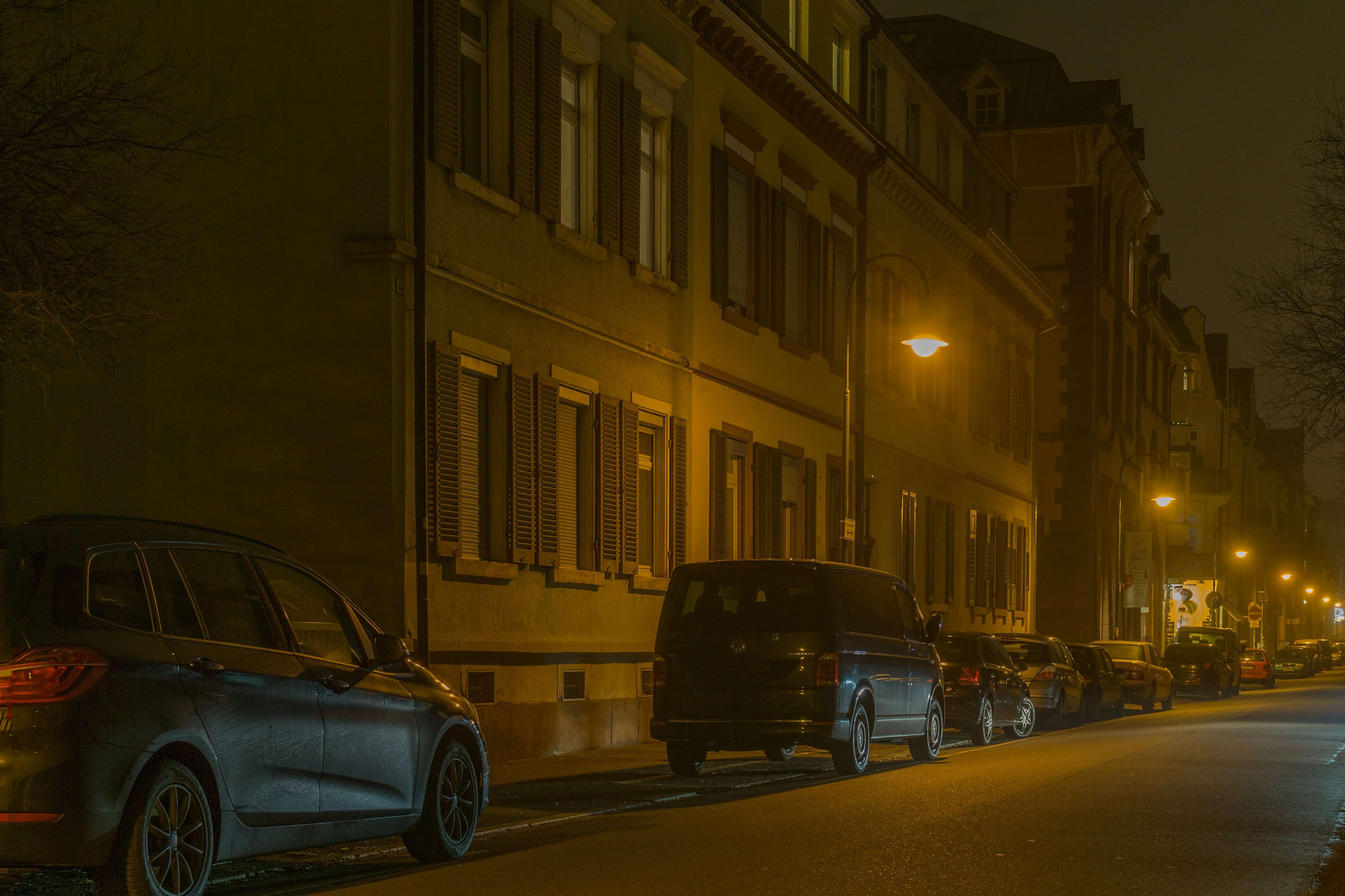 Cars in illuminated city at night photo