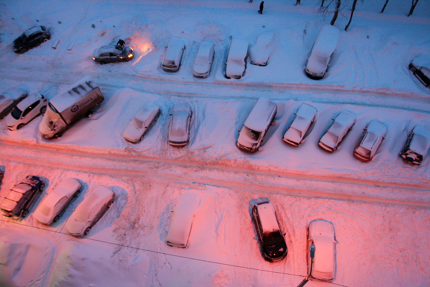 Cars parked in snow photo