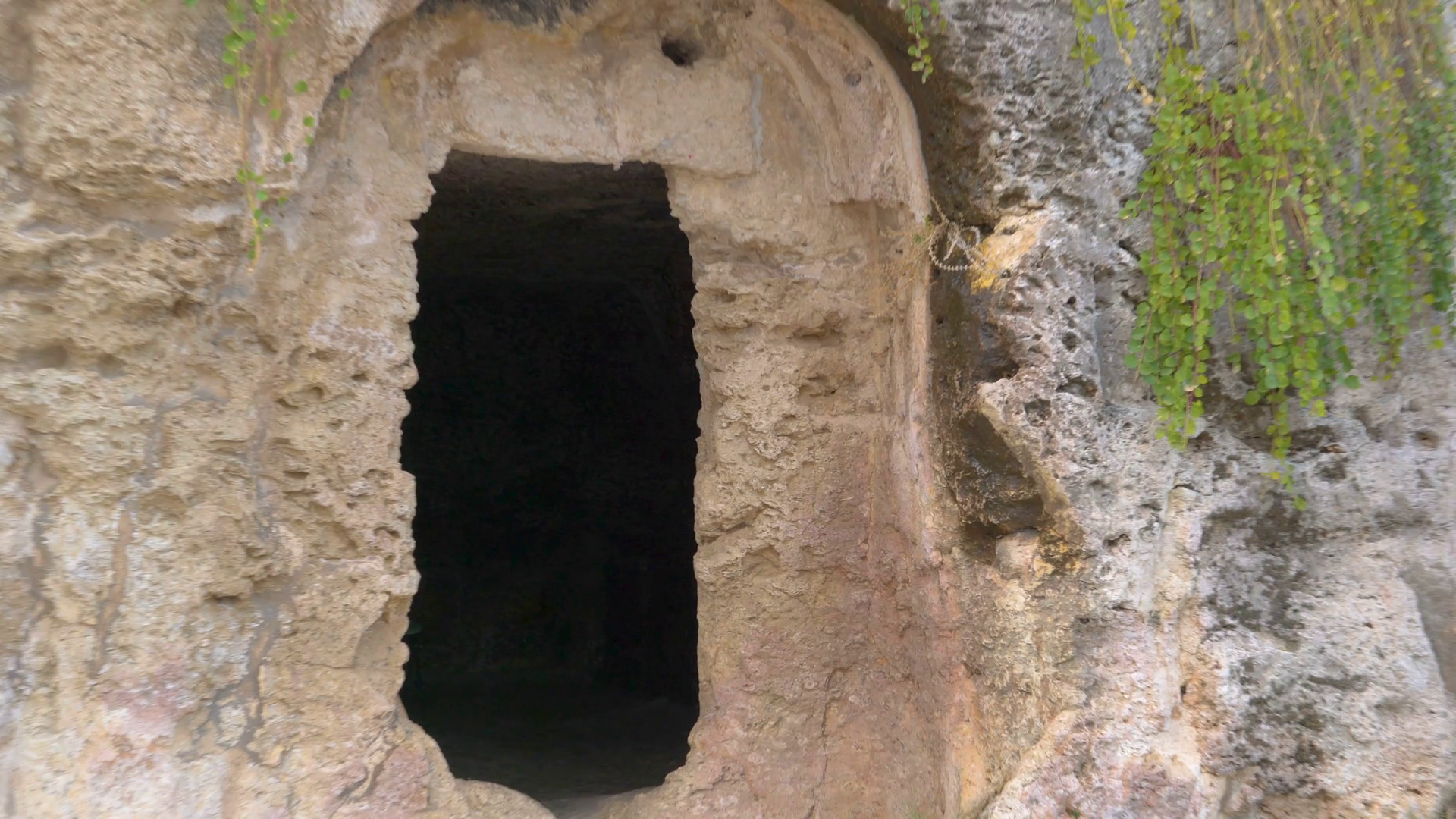 Closer look of the small hole in the cave in Neapolis in Siracusa ...
