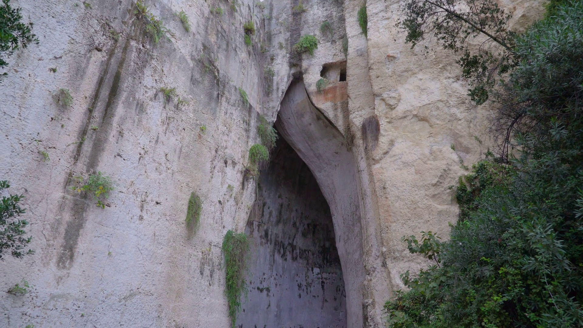 The entrance of Ear of Dionysius in Neapolis Siracusa Italy Stock ...