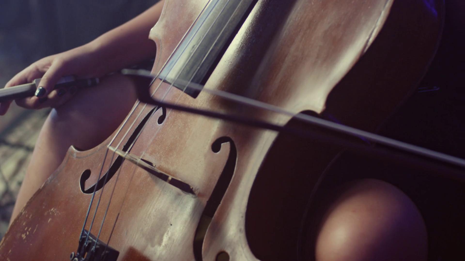 Cello player. Cellist playing violoncello. Close up of cello. Cello ...